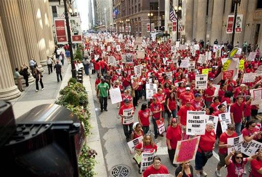Thousands of public school teachers march for the second consecutive day on Tuesday, Sept. 11, 2012 in downtown Chicago. Teachers walked off the job Monday for the first time in 25 years over issues that include pay raises, classroom conditions, job security and teacher evaluations.