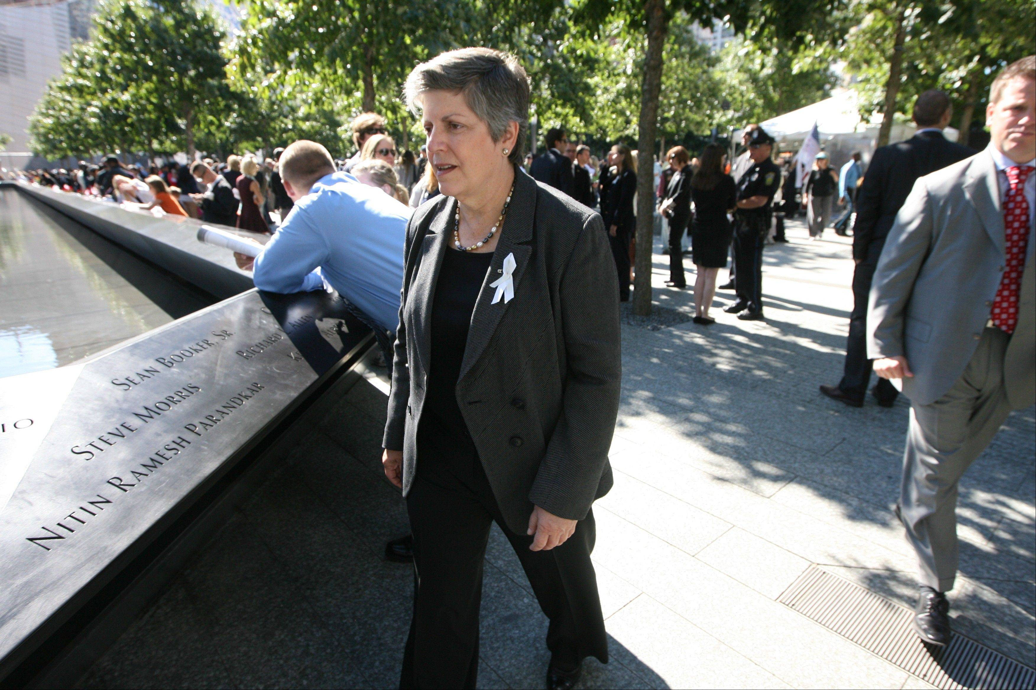 Homeland Security Secretary Janet Napolitano walks past the north reflecting pool Tuesday during a ceremony marking the 11th anniversary of the Sept. 11 terrorist attacks, at the National September 11 Memorial at the World Trade Center site in New York.