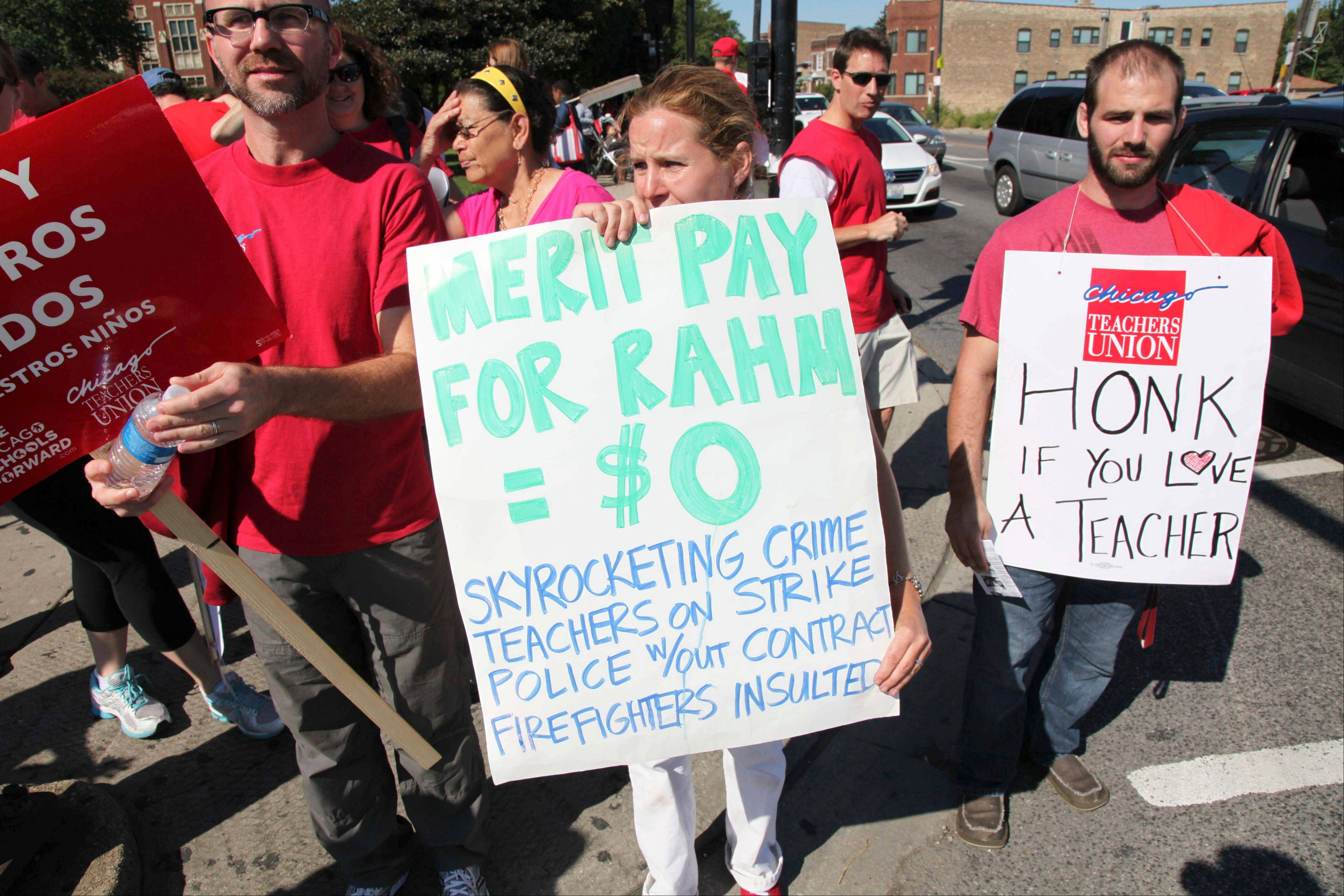 Chicago public school teachers walk a picket line outside Lane Tech High School on Tuesday, the second day of a strike.