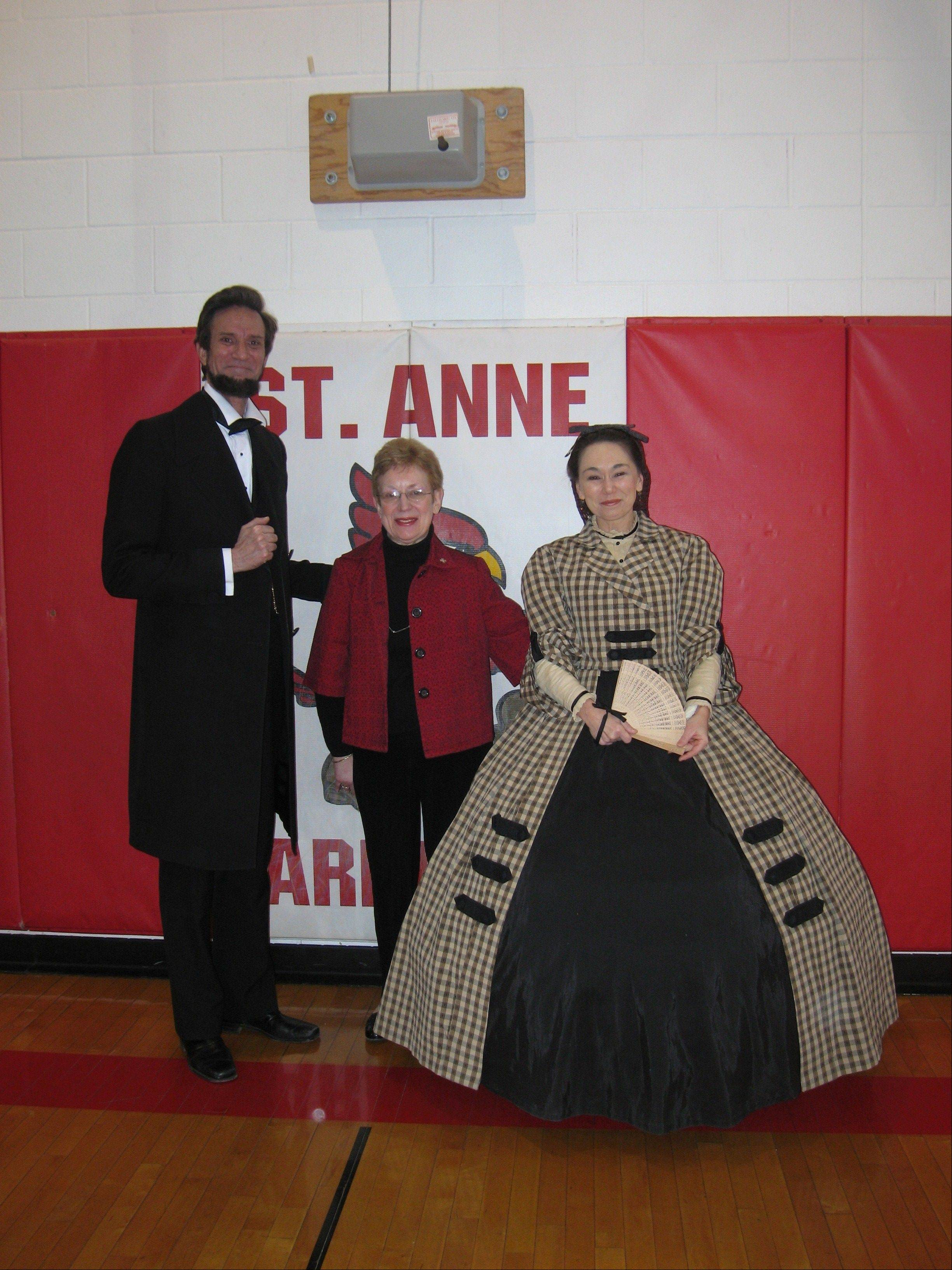 St. Anne Principal Sister Ann Busch poses with Abraham Lincoln and Mrs. Lincoln, following a 2009 presentation at the school. The Lincolns were portrayed by Michael Krebs and Debra Ann Miller.