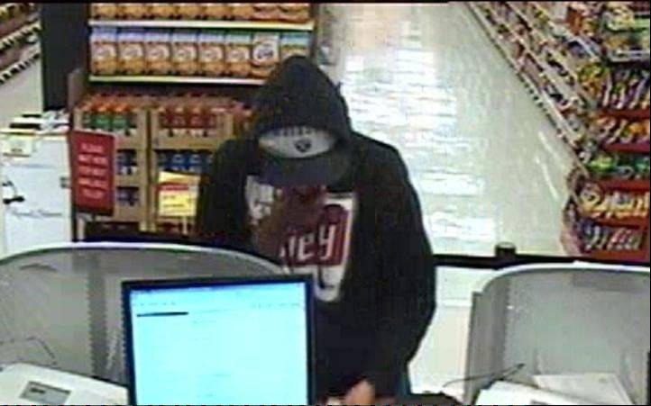Photo courtesy of the FBISurveillance footage shows a man robbing a TCF Bank branch inside the Jewel-Osco at 885 E. Belvidere Road in Grayslake Monday. Two suspects were arrested and charged in connection to the robbery.