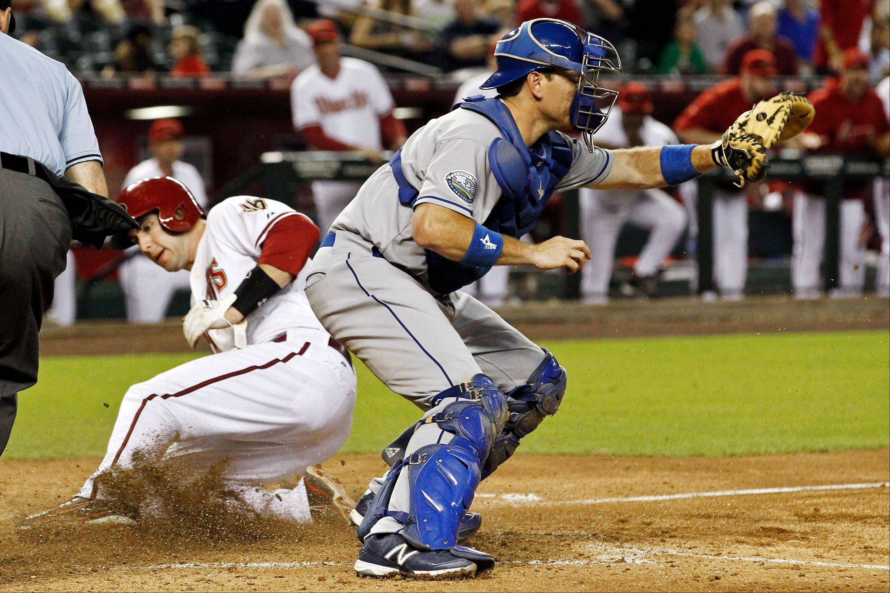 The Diamondbacks' Paul Goldschmidt scores as Los Angeles Dodgers catcher A.J. Ellis waits for a late throw during the seventh inning Tuesday in Phoenix.