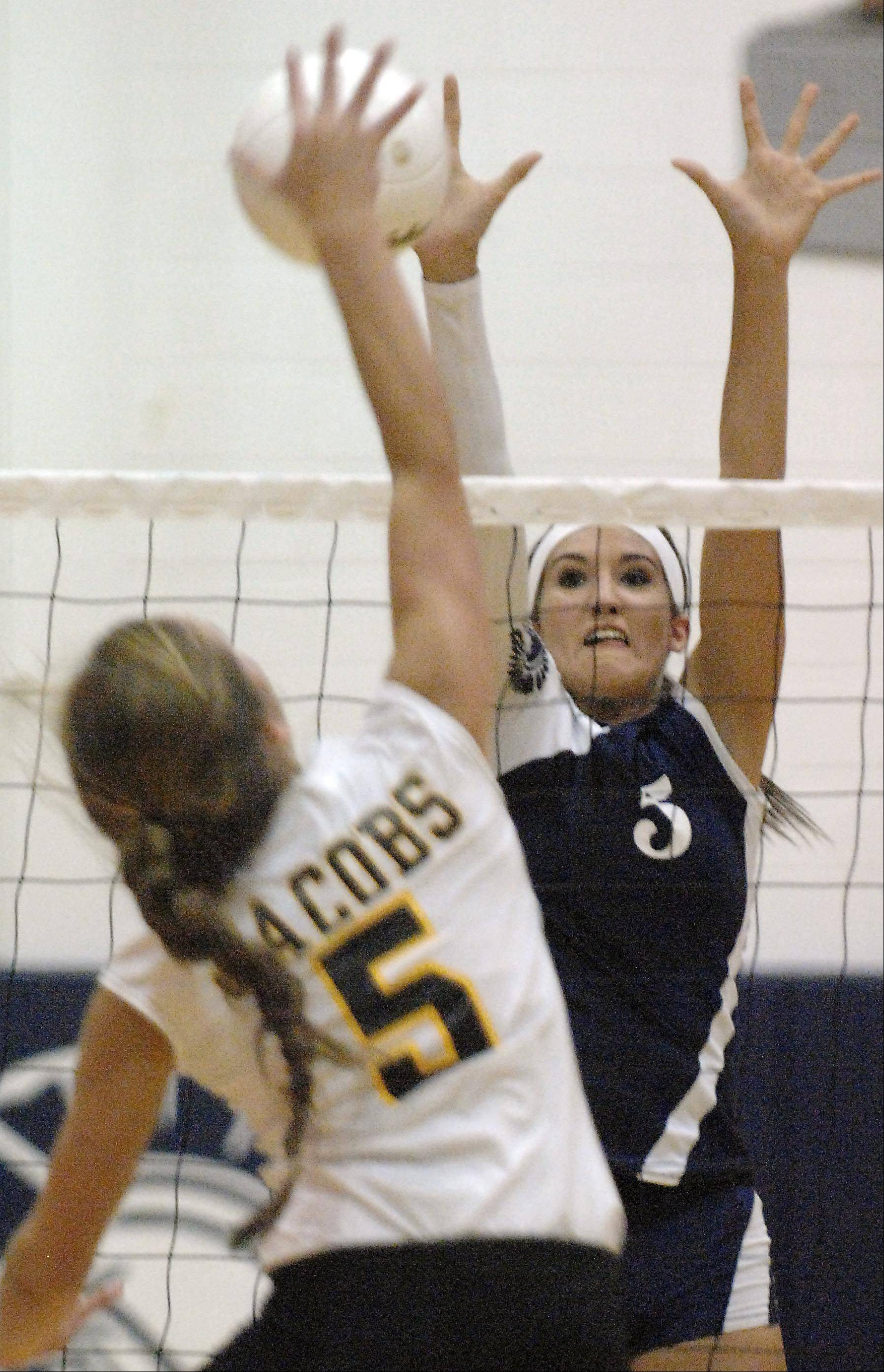Cary-Grove's Kayli Trausch goes up to block Jacobs' Maris Smith Tuesday in Cary.