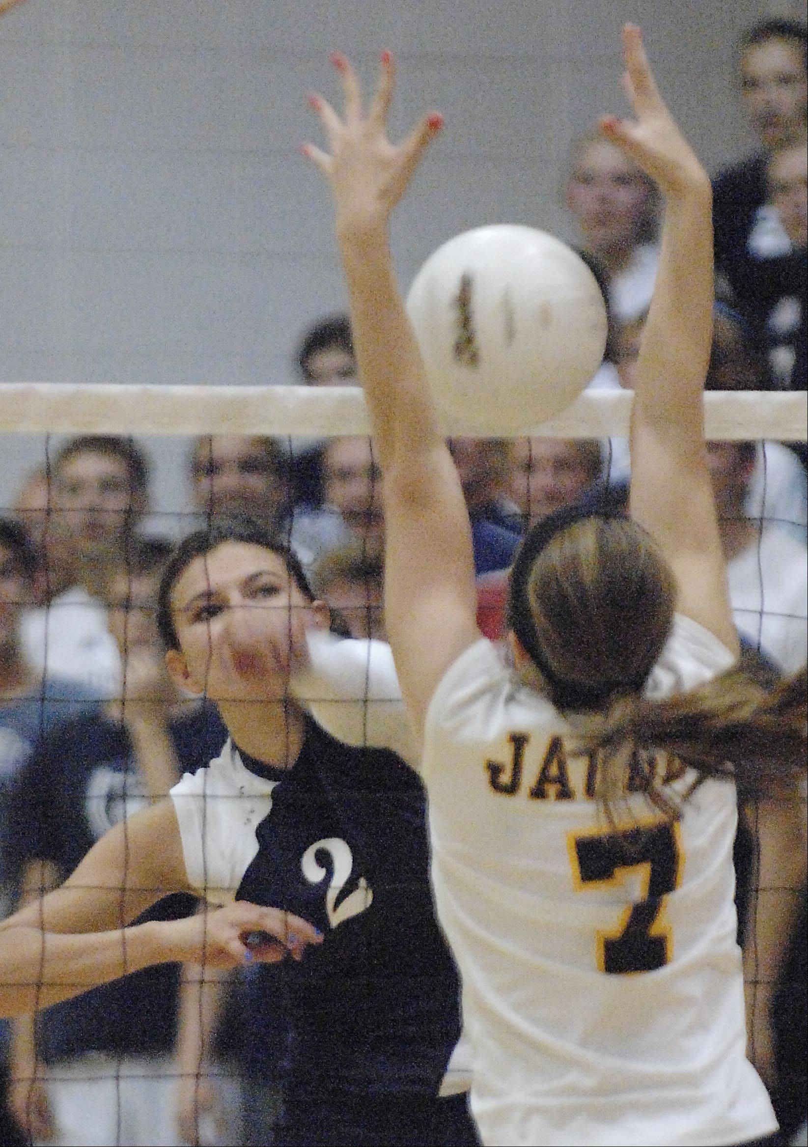 Cary-Grove's Alex Larsen tries to get a shot past Jacobs' Rachel Arceneaux Tuesday in Cary.
