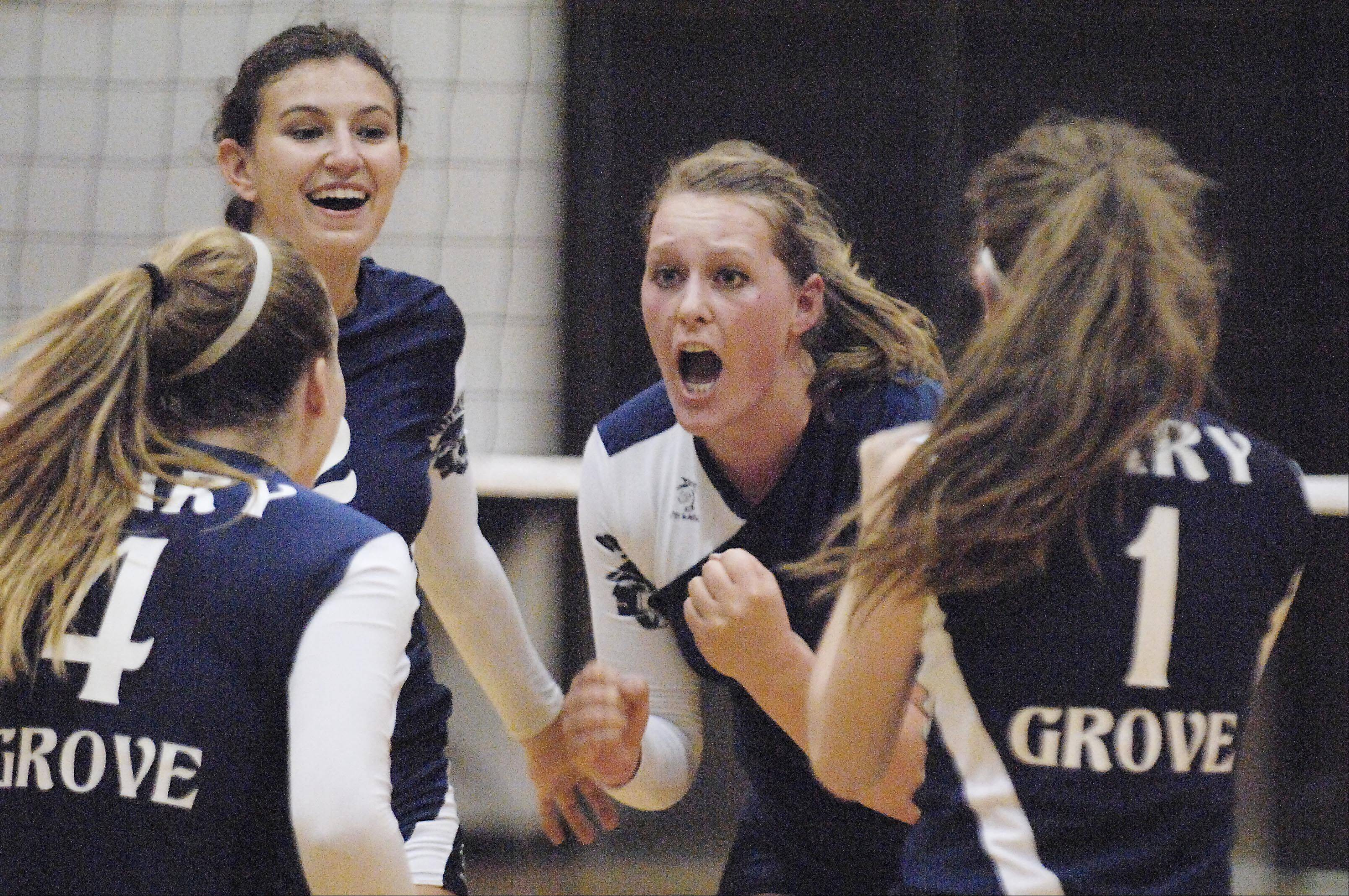 Cary-Grove's Mallory Wilczynski rallies her teammates against Jacobs Tuesday in Cary.