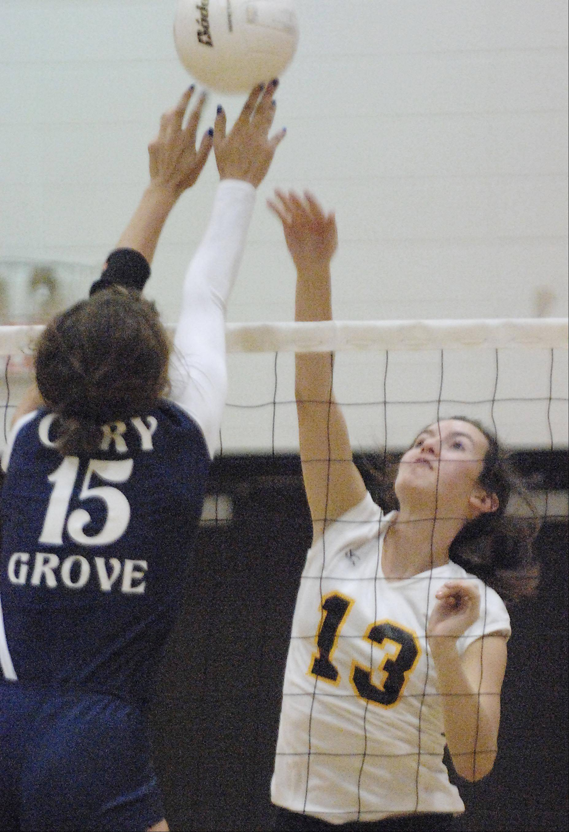 Jacobs' Katie Mahoney gets the ball over the fingertips of Cary-Grove's Jess Bartczyszn Tuesday in Cary.
