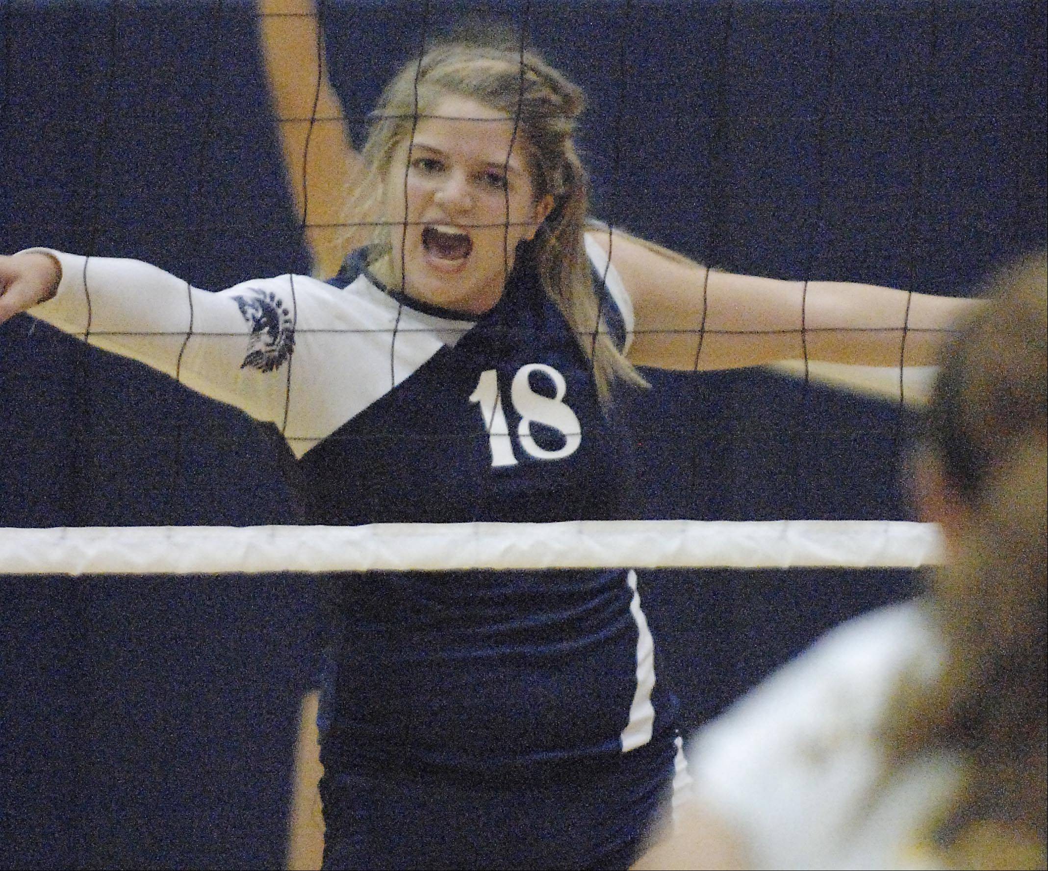Cary-Grove's Ally Vasquez vocalizes her thoughts against Jacobs Tuesday in Cary.