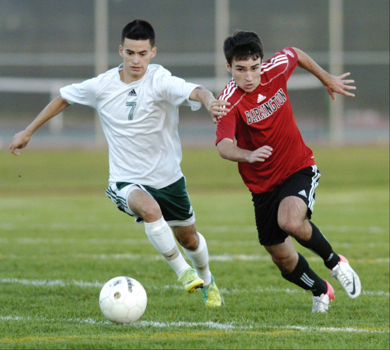 Elk Grove's Hugo Sanchez, left, and Barrington's Ethan Claes pursue the ball during Tuesday's game.