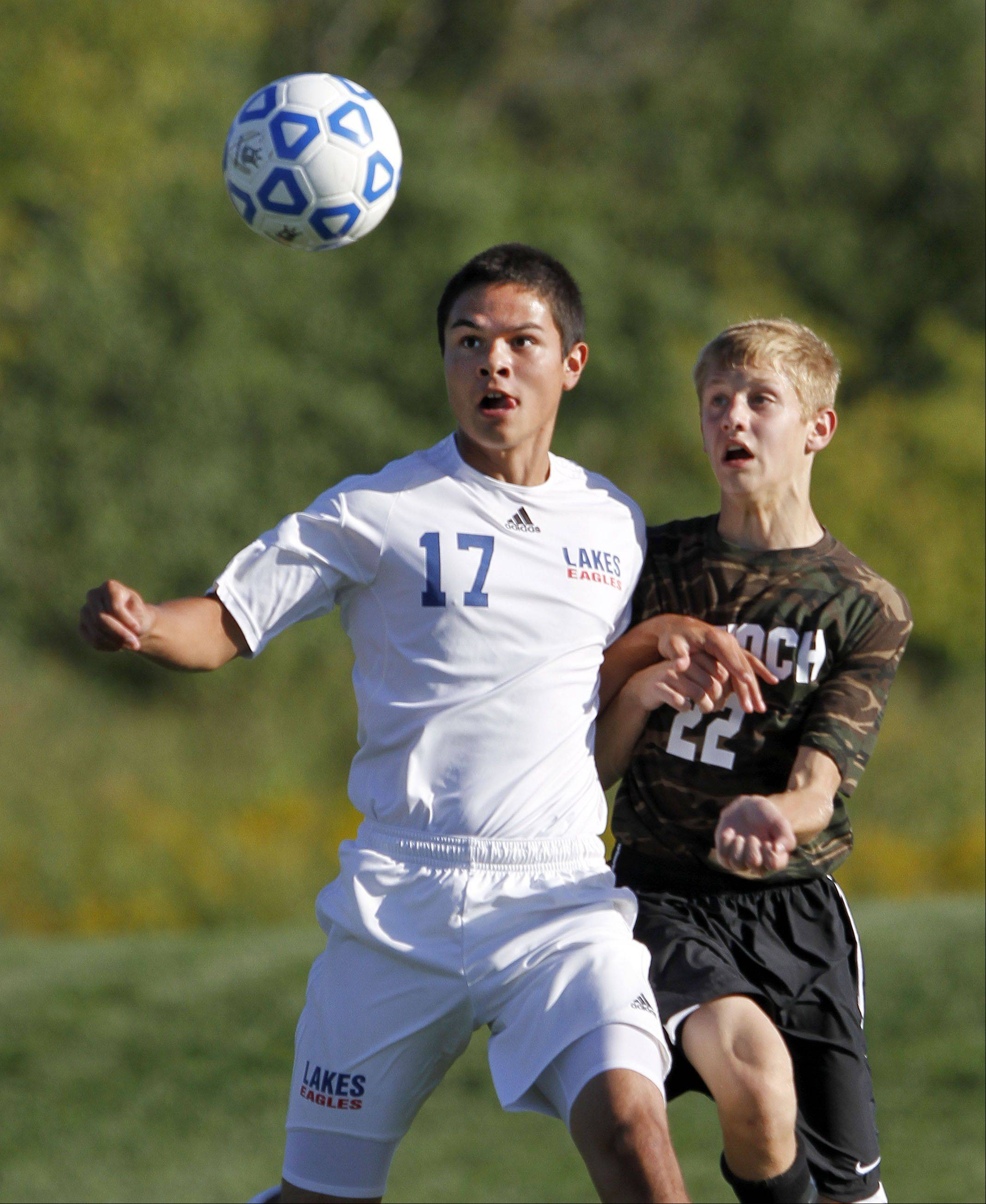 Lakes' Parker Edwards, left, and Antioch's Danny Brito battle for the ball Tuesday at Lakes.