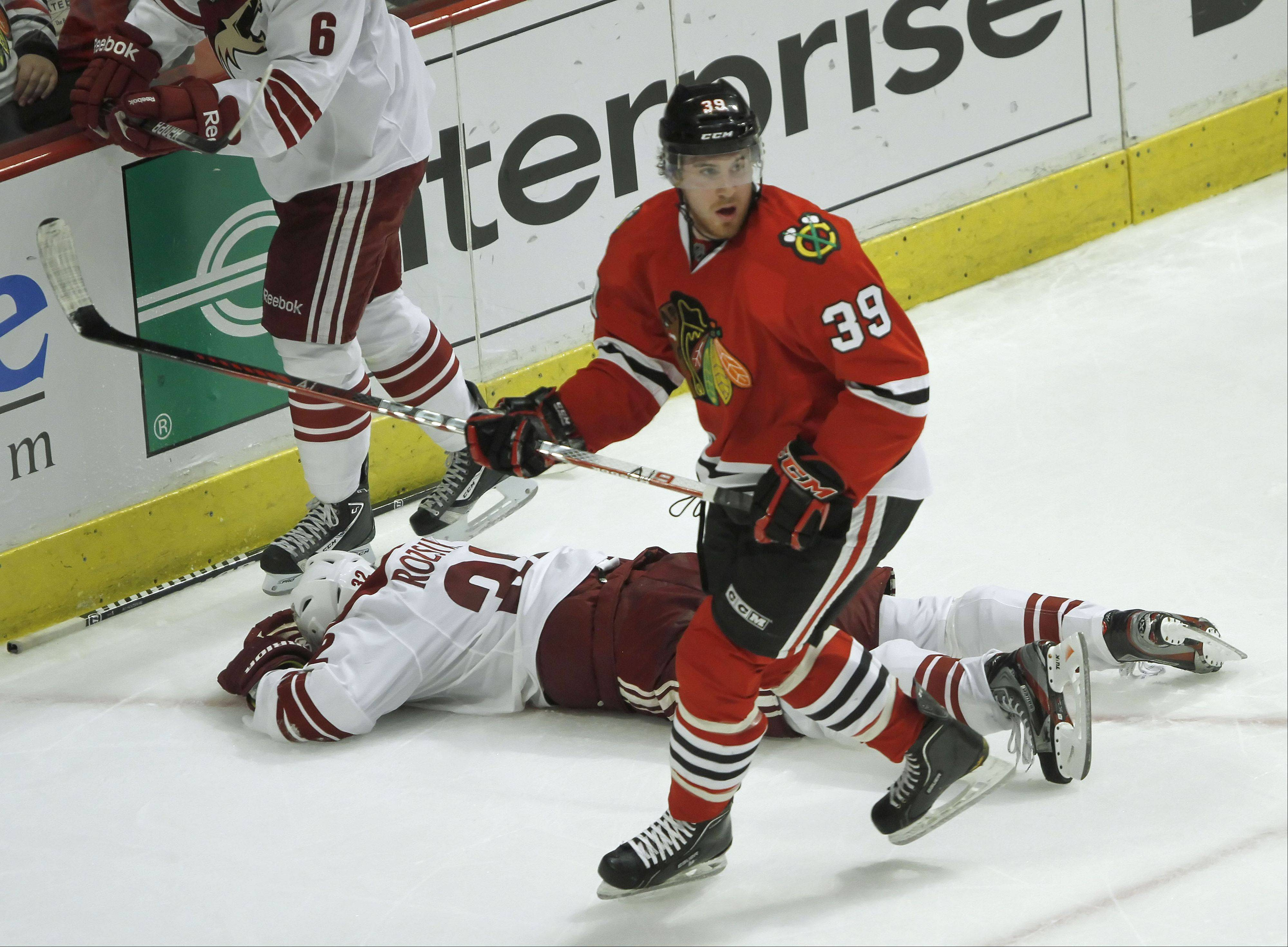 Former Phoenix Coyotes defenseman Michal Rozsival, shown here sprawled on the ice, might remember this hit by Blackhawks right winger Jimmy Hayes in the playoffs. Rozsival has agreed to a one-year contract with the Blackhawks.