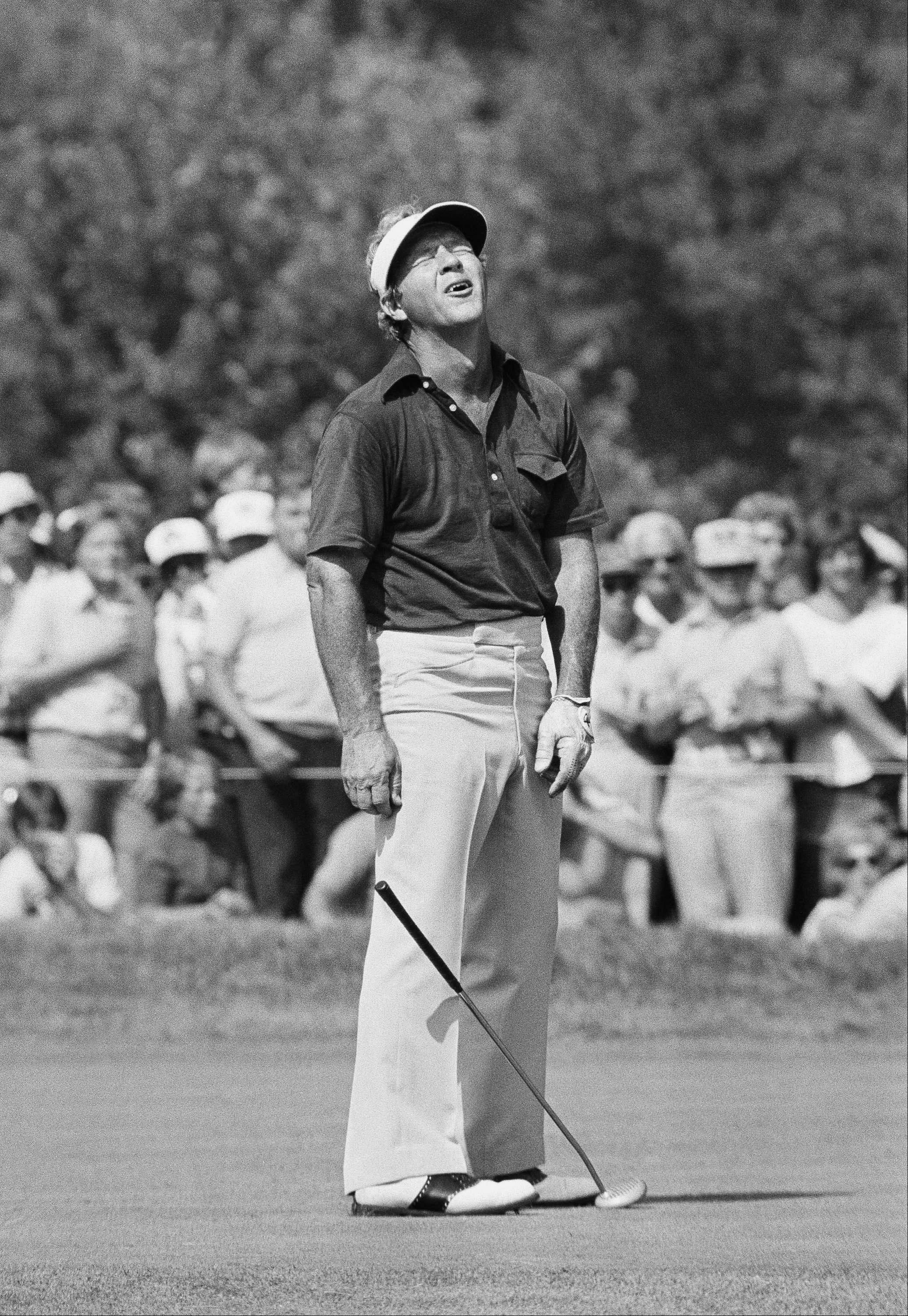 Arnold Palmer leaves nothing unsaid as he presented this appearance when he missed a putt that gave him a bogey on the par four, 11th hole at Medinah Country Club, Medinah, Ill., June 19, 1975, in the first round of the U. S. Open. Palmer, of Ligonier Pa., was trailing the leaders by one stroke when he missed this putt.