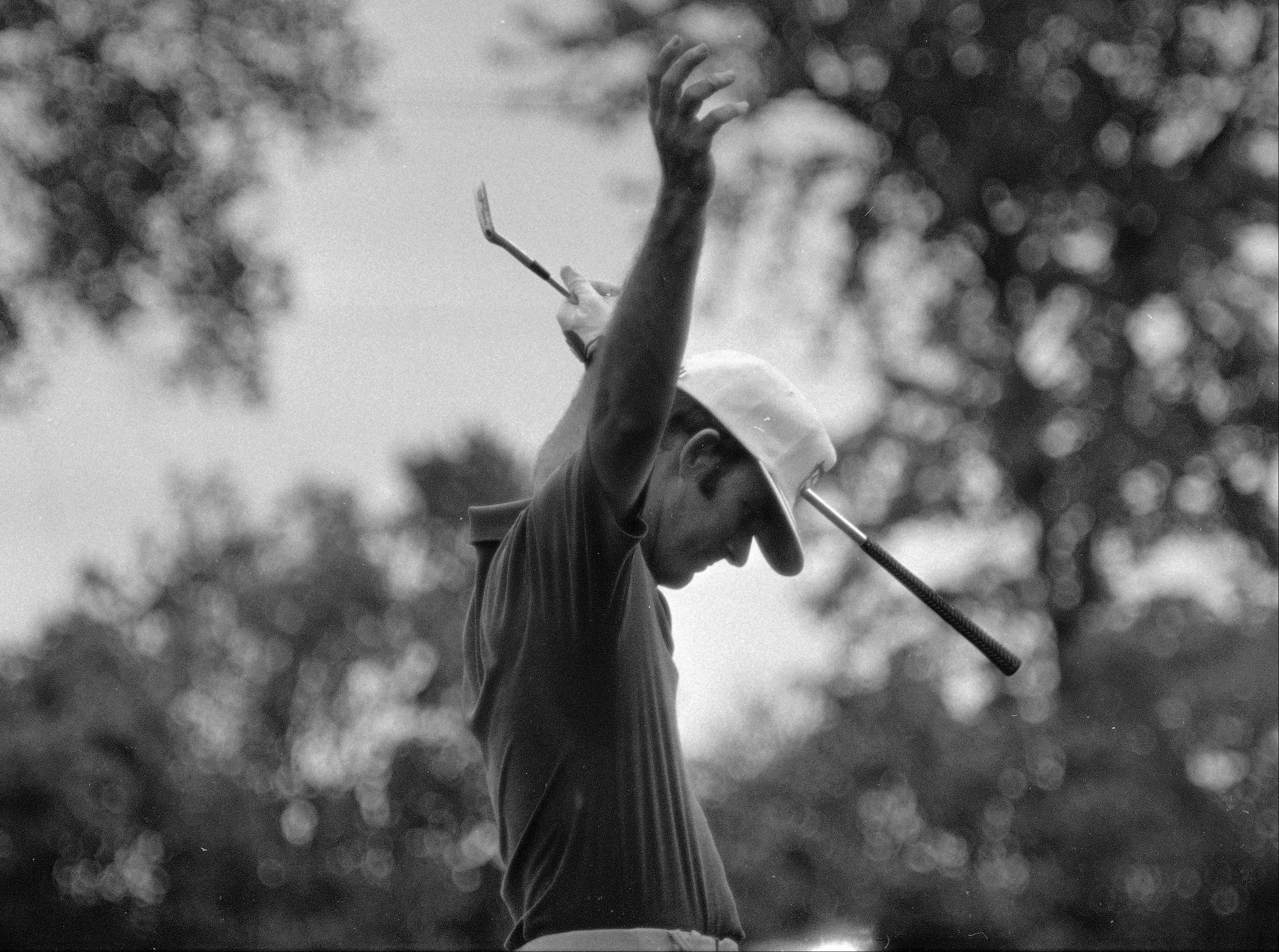 Lou Graham waves his arms after hitting a shot from the rough to within three feet of the pin on the 583-yard, par, five 10th hole at Medinah, June 23, 1975. Graham went on to sink the putt for a birdie and go three-up on his opponent John Mahaffey, Jr., in the U.S. Open playoff.