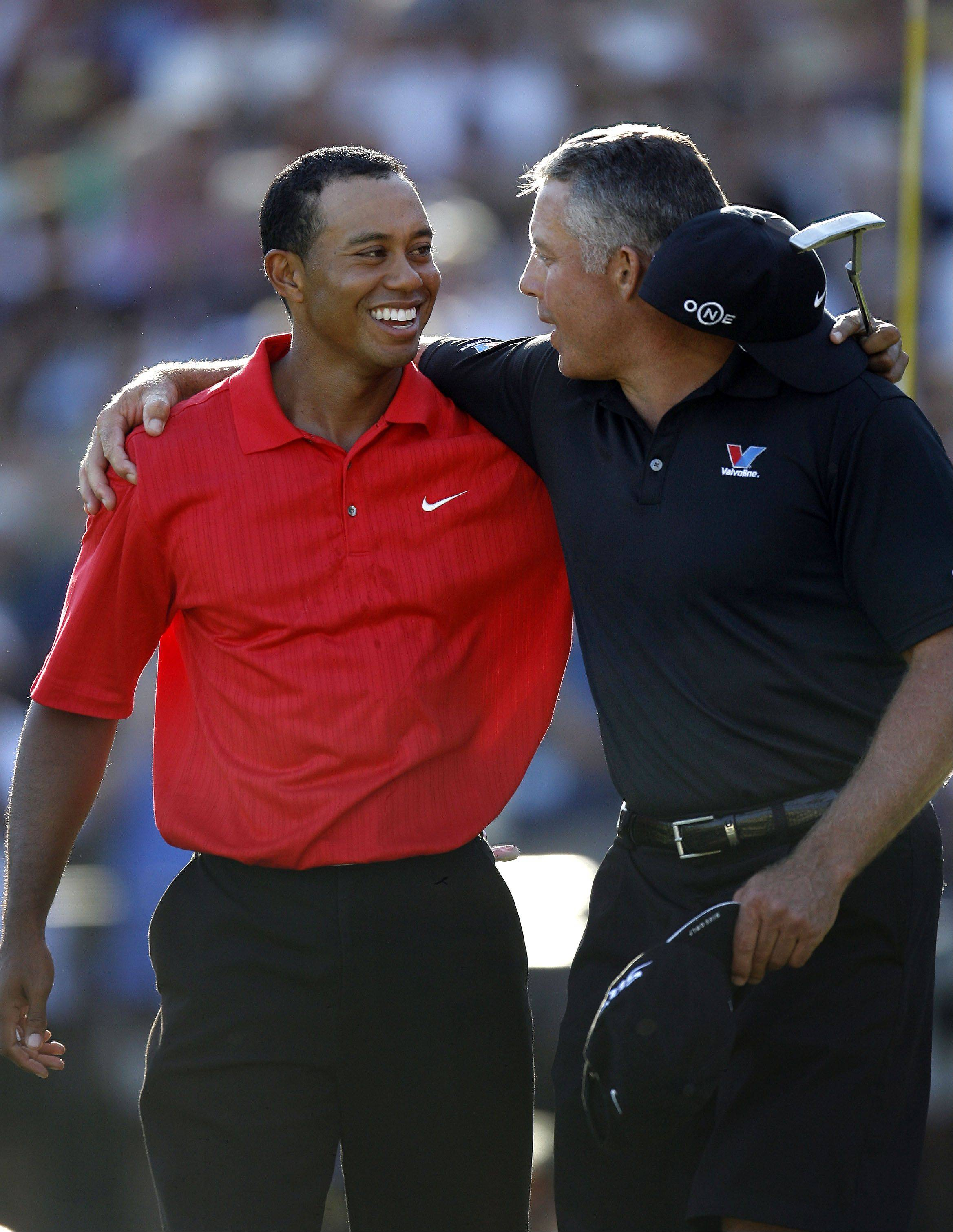 Round four of the 88th PGA Championship Sunday, August 20, 2006 at Medinah Country Club in Medinah. Tiger and Steve Williams celebrate.