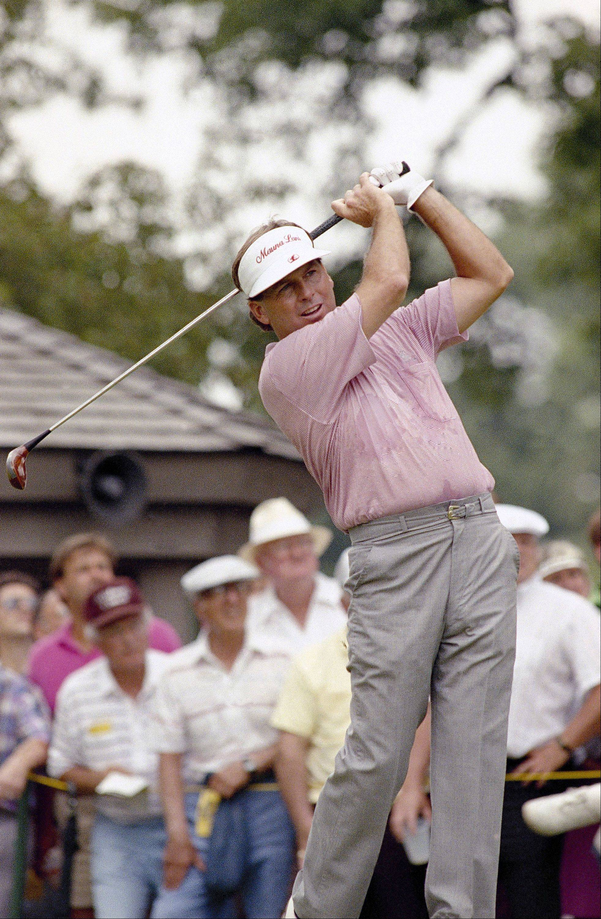 Lanny Wadkins, professional golfer, tees off during the U.S. Open, at the Medinah Country Club in Medinah, Illinois, June 14, 1990.