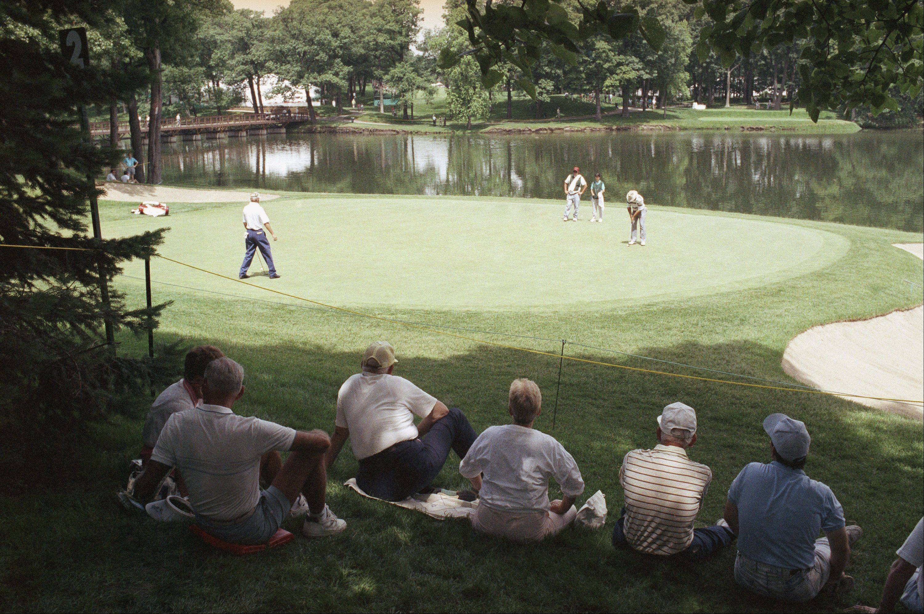 People in the gallery watch golfers on the No. 2 green at Medinah Country Club, Medinah Monday, June 11, 1990. The golfers are practicing for the U.S. Open, which begins Thursday.