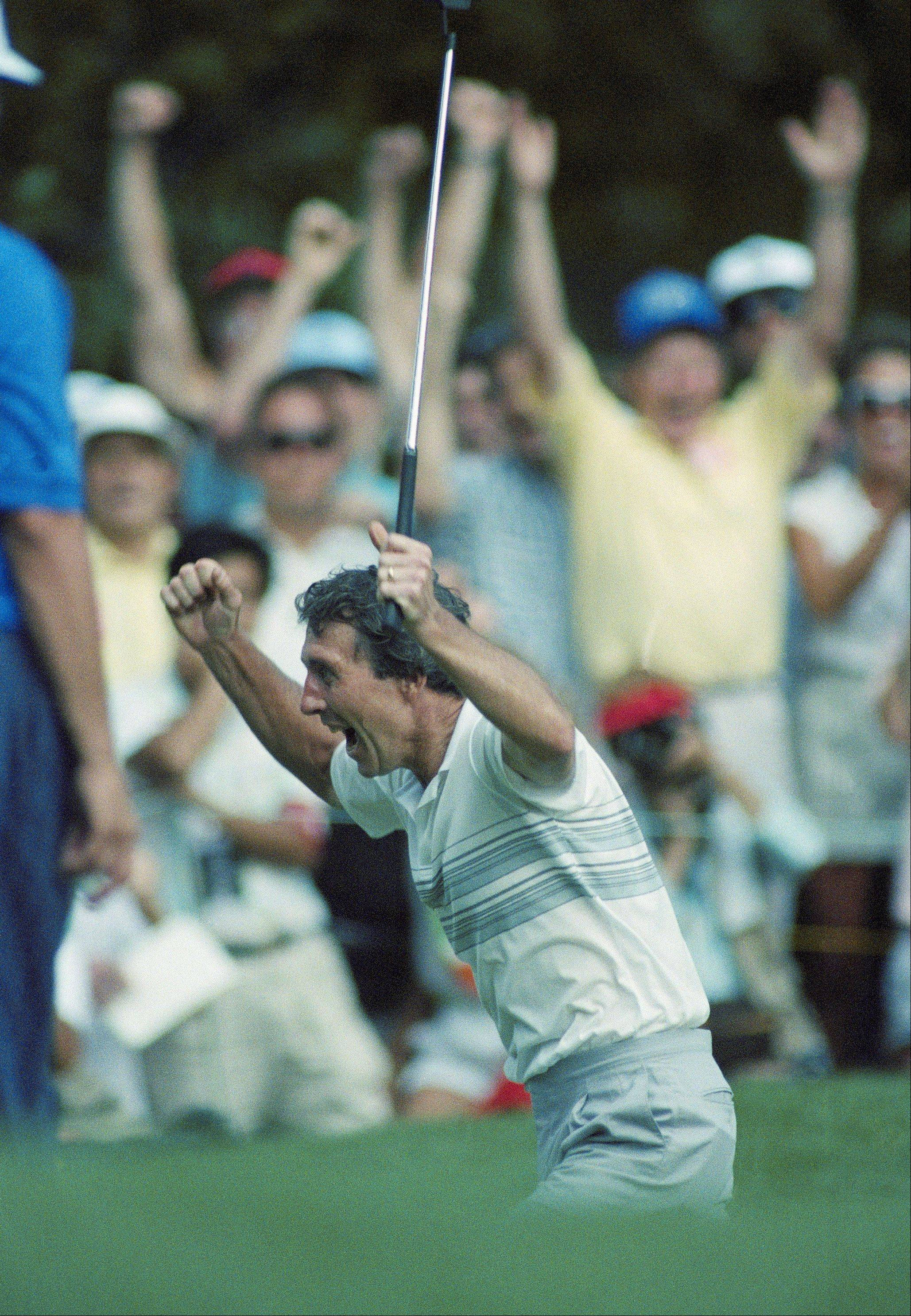 Hale Irwin jumps for joy after sinking a birdie putt on the 19th playoff hole Monday, June 18, 1990 with Mike Donald during the U.S. Open at Medinah Country Club in Medinah.