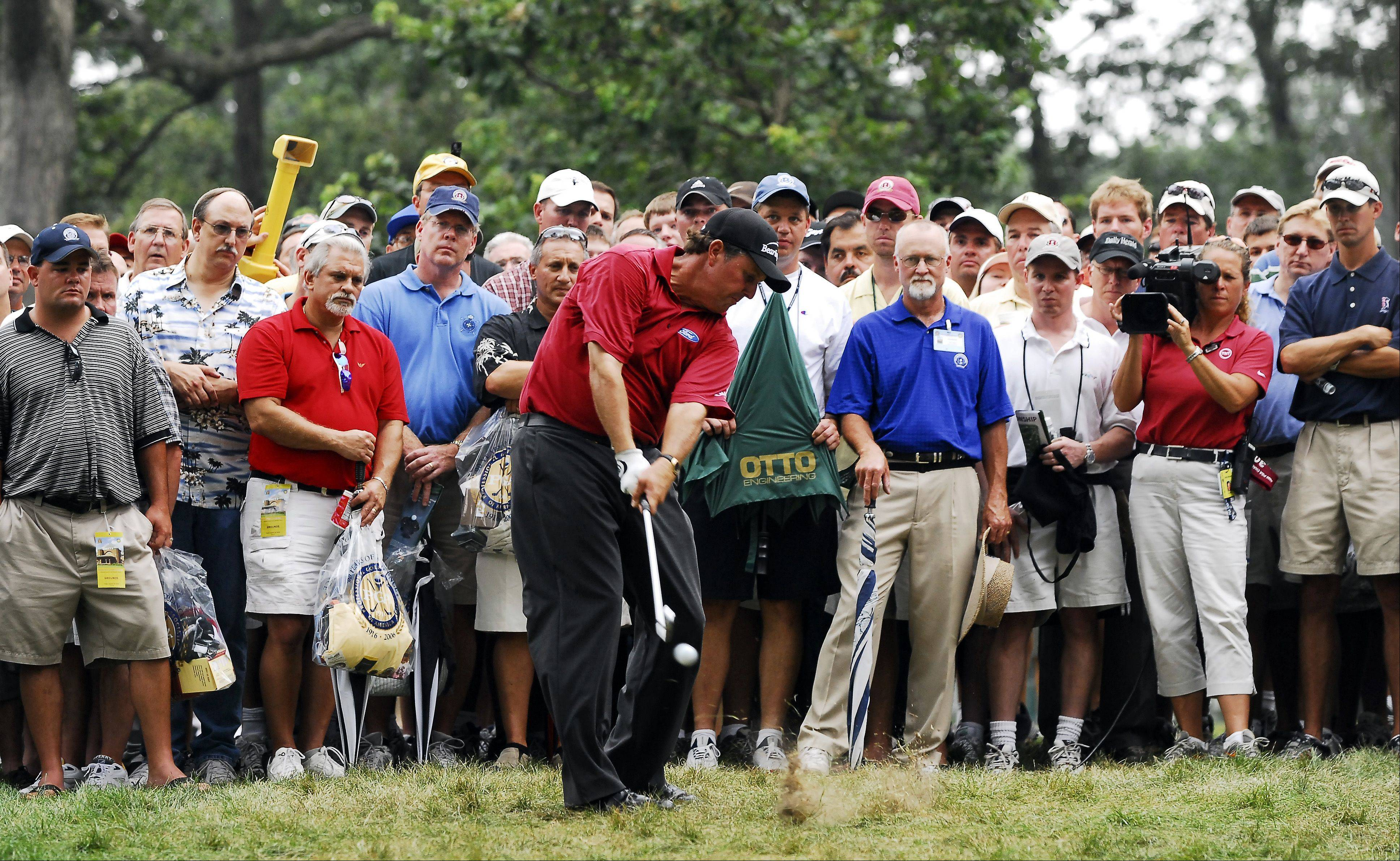 Round two of the 88th PGA Championship Friday; August 18, 2006 at Medinah Country Club in Medinah. Here Phil Mickelson hits from the crowd on the 4th.