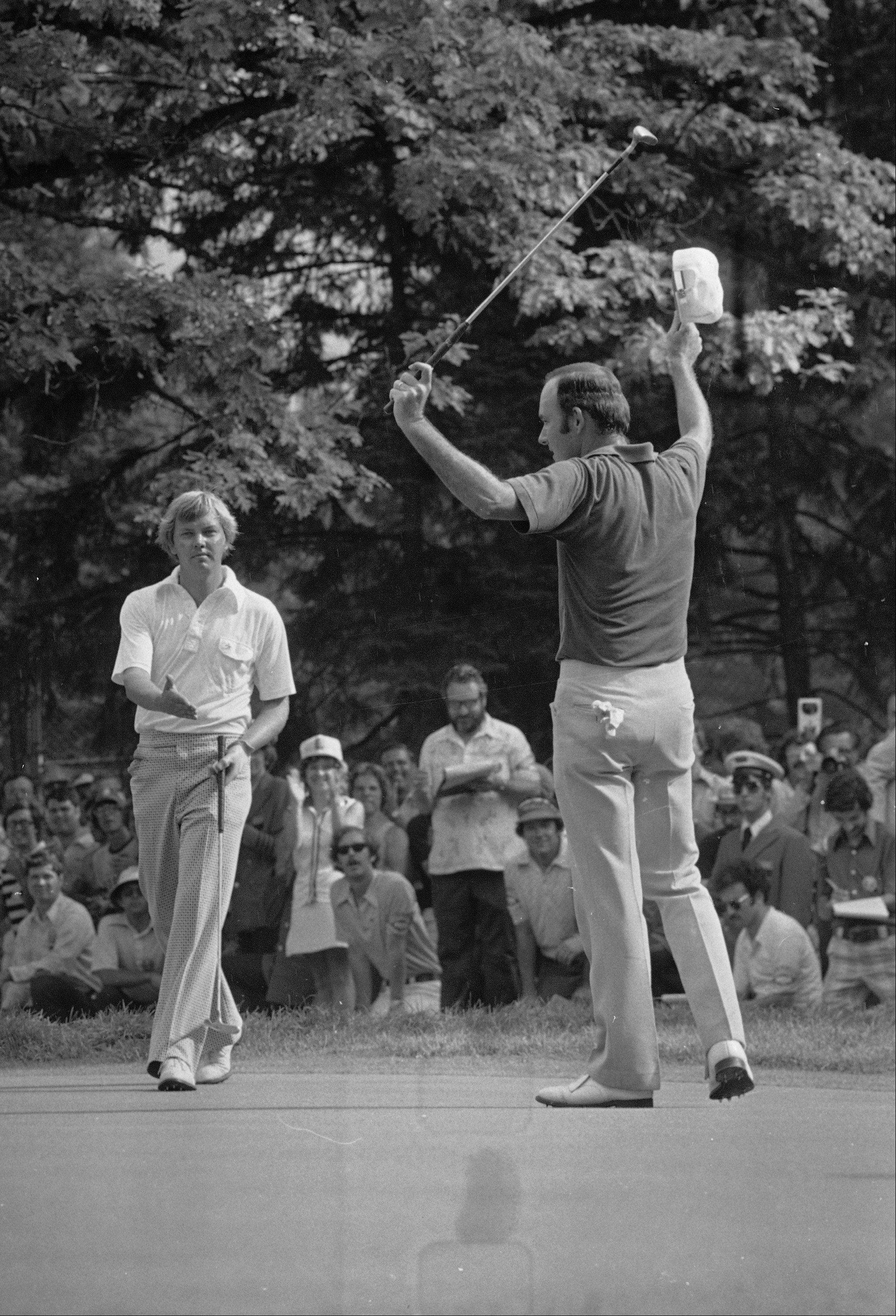 John Mahaffey, Jr., left, reaches out his hand to congratulate Lou Graham on Medinah's 18th green where Graham won the U.S. Open championship by one stroke in the playoff, June 23, 1975.