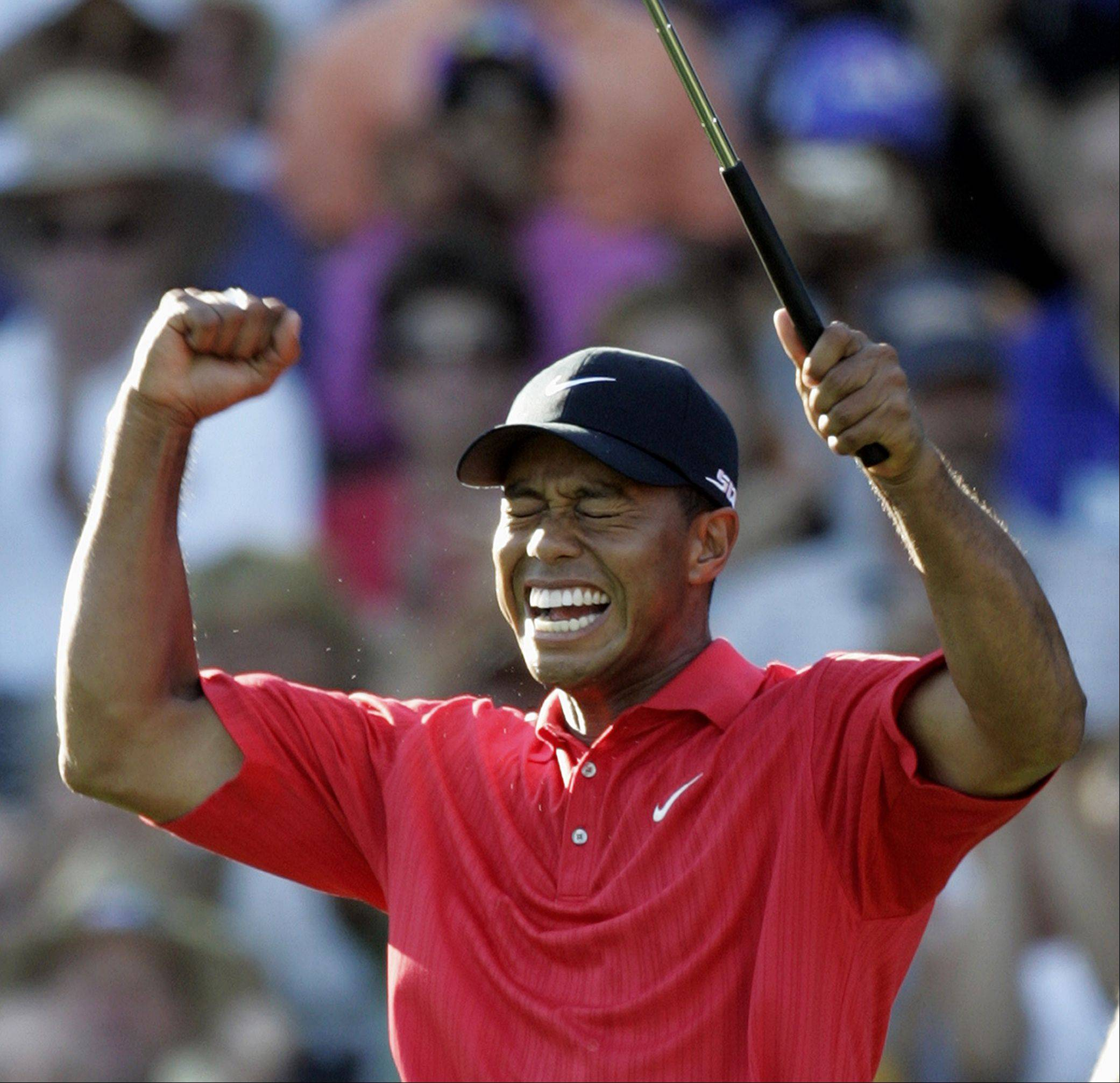 This is an Aug. 20, 2006, file photo showing Tiger Woods celebrating after winning 88th PGA Championship golf tournament at Medinah Country Club Sunday, in Medinah.