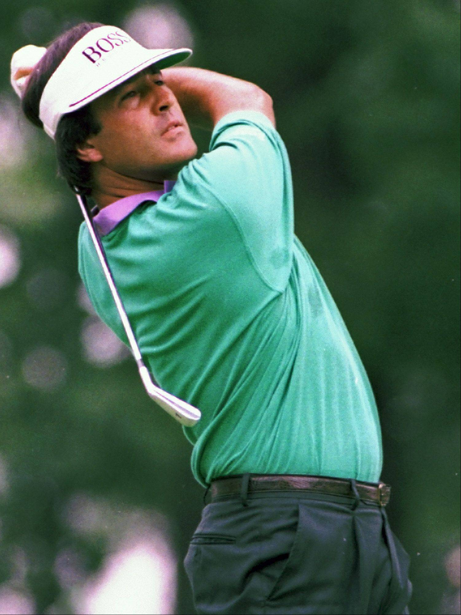 In this June 1990 file photo, Seve Ballesteros hits an iron off the tee during the U.S. Open golf tournament at Medinah Country Club in Medinah, Ill. Ballesteros died early Saturday, May 7, 2011, from complications of a cancerous brain tumor. He was 54.