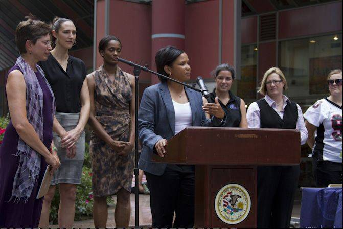 "Lt. Gov. Sheila Simon, from left, Sky center Ruth Riley, Sky forward Swin Cash, and Sky coach Pokey Chatman at the podium during ""Girls Run This Game,"" a special program put on by the Sky and the Girl Scouts at the Allstate Arena in June to celebrate the 40th anniversary of Title IX and the 100th anniversary of the Girl Scouts."