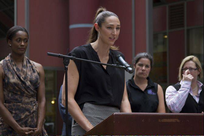 "Chicago Sky center Ruth Riley speaks at the ""Girls Run This Game"" program in June."