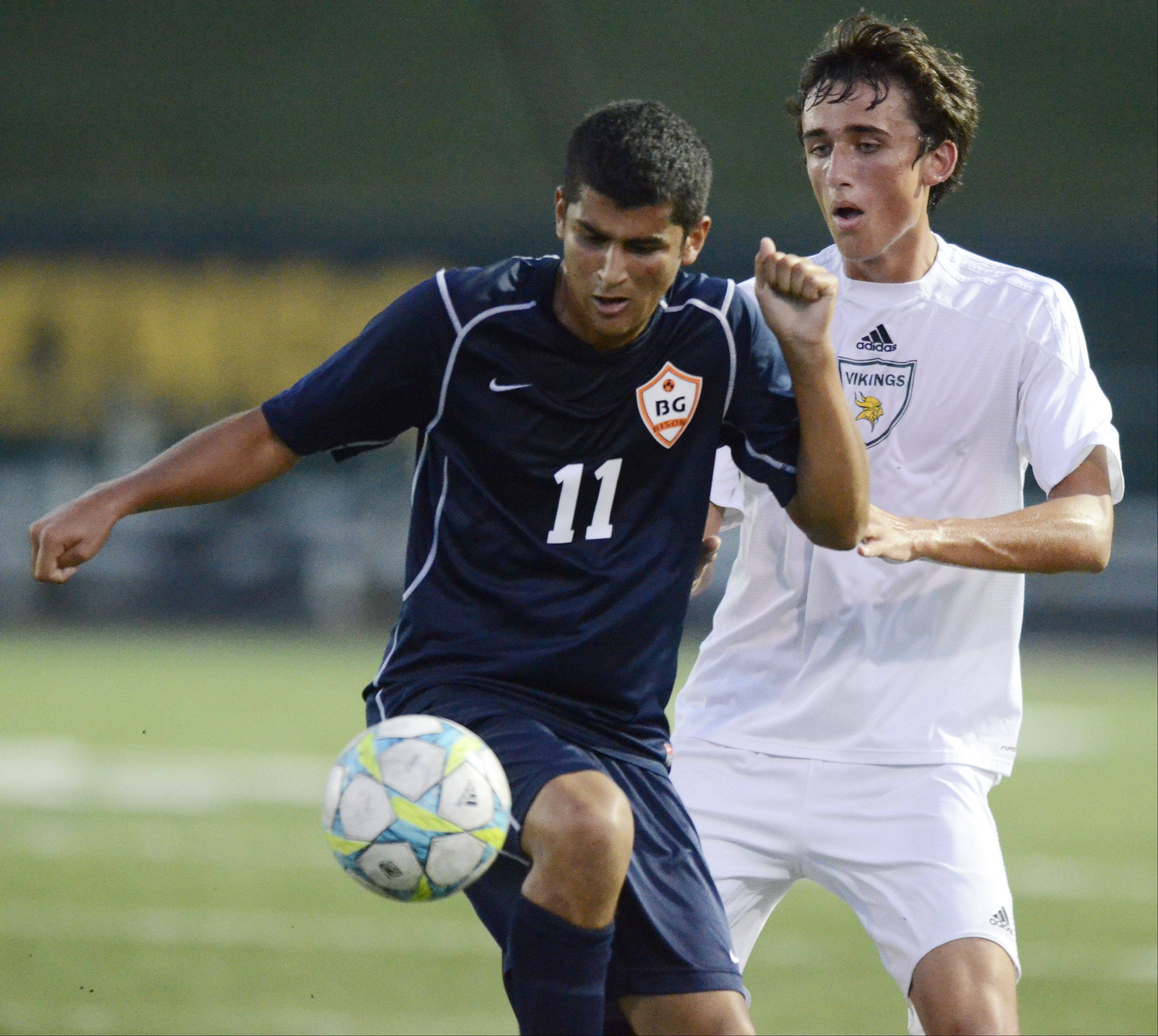Buffalo Grove's Daniel Ramirez, left, tries to control the ball in front of Fremd's Nate Hellwarth during Tuesday's game.