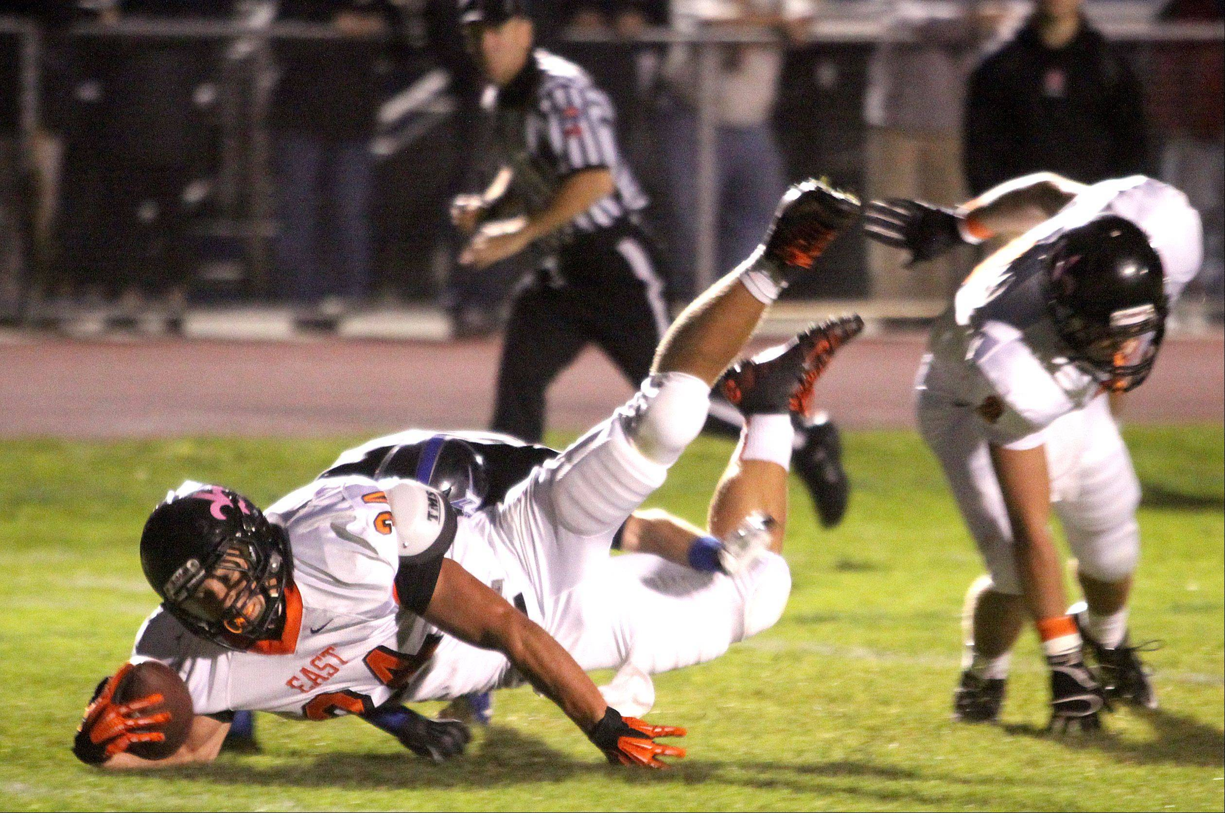 St. Charles East's Joe Hoscheit dives for extra yardage during Friday's football game at St. Charles North.