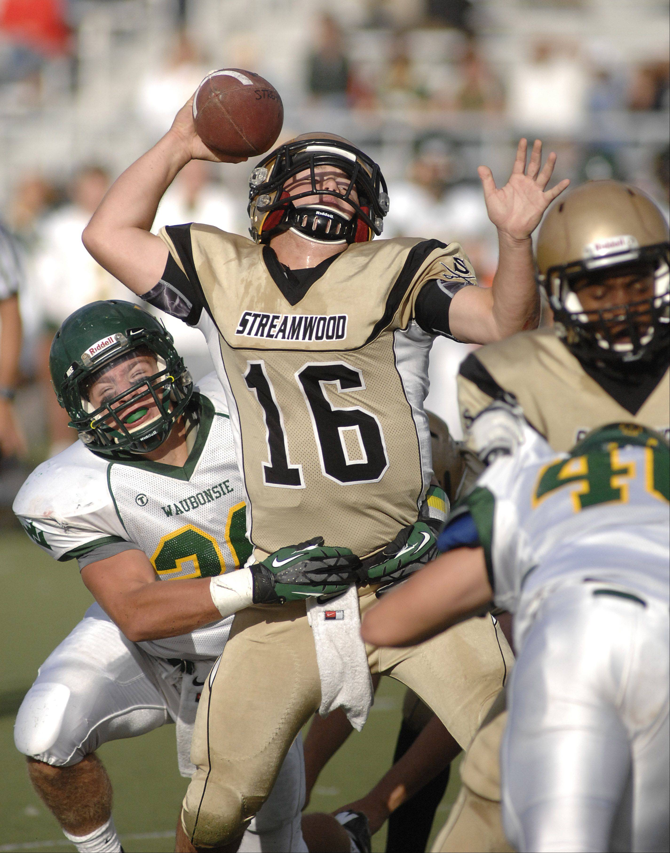 Waubonsie Valley's Hugh Griffin sacks Streamwood quarterback Mason Polich during Saturday's game.