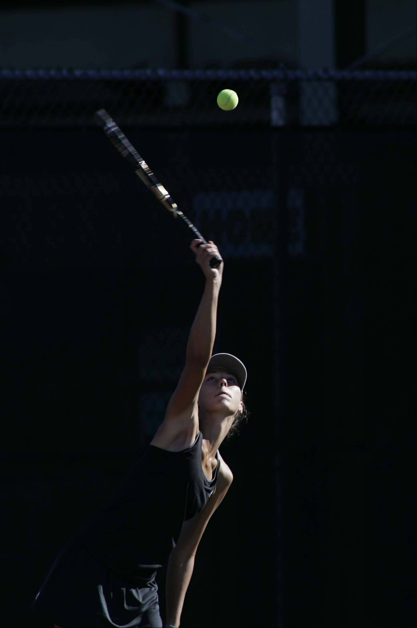 Batavia's Jenny Mizikar serves during the St. Charles East girls tennis invite Saturday.