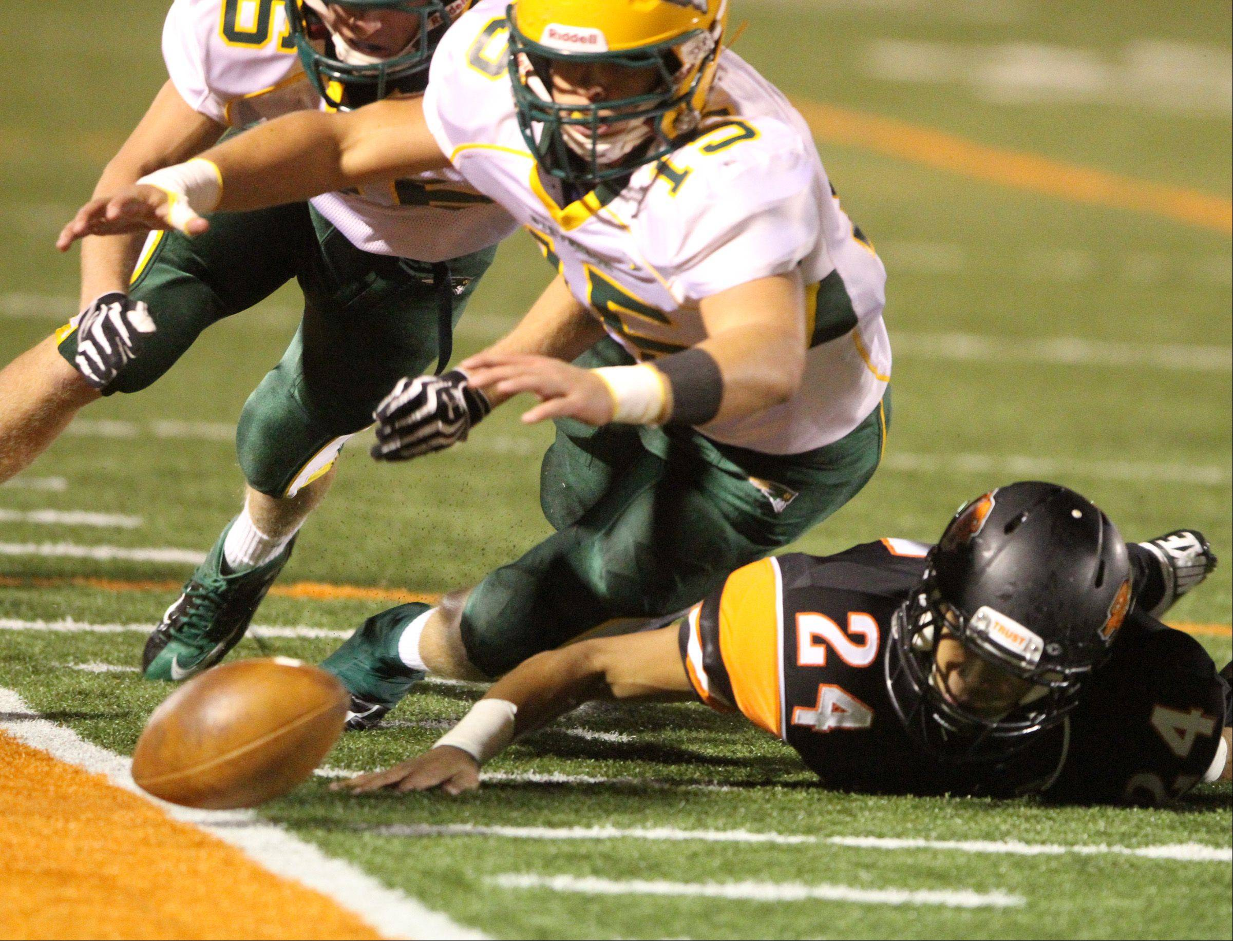 Stevenson's Sean O'Connell dives for the ball after a fumble by Libertyville on Friday.
