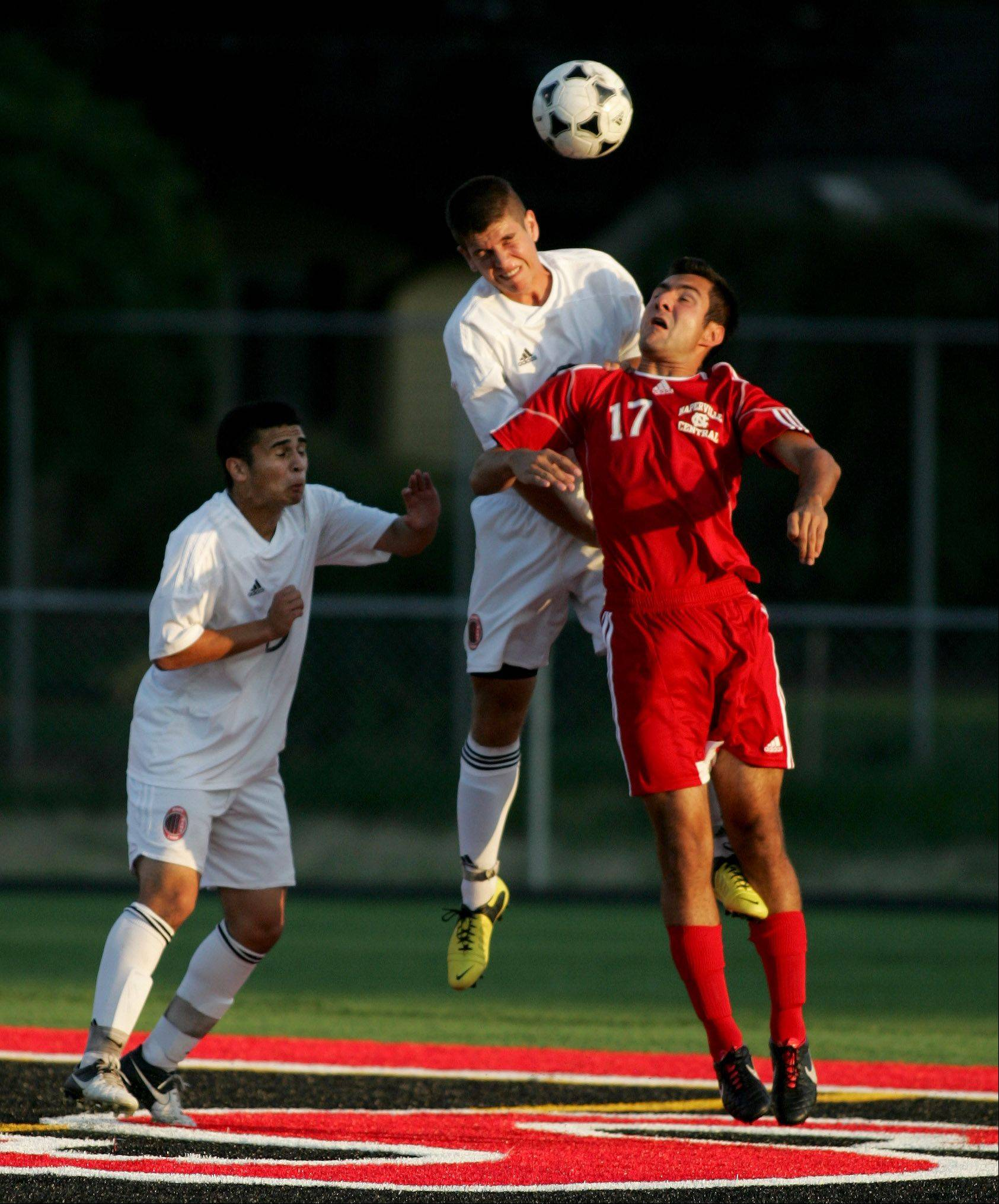 Carlos Urbina, from left, Matt Rossetti, of Glenbard East and Connor Allen of Naperville Central in boys soccer action Tuesday in Lombard.