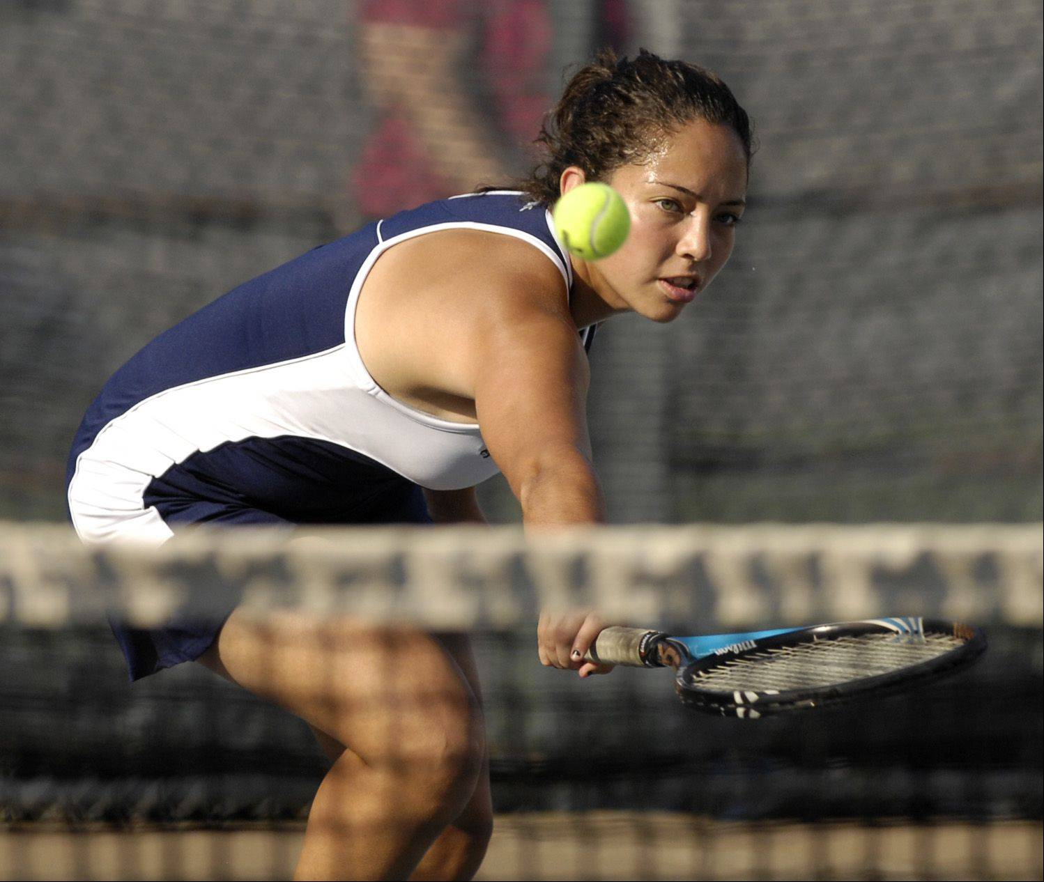 West Chicago's Daniela Garcia plays Katherine Hinman of Willowbrook during Wednesday's tennis match in Villa Park.