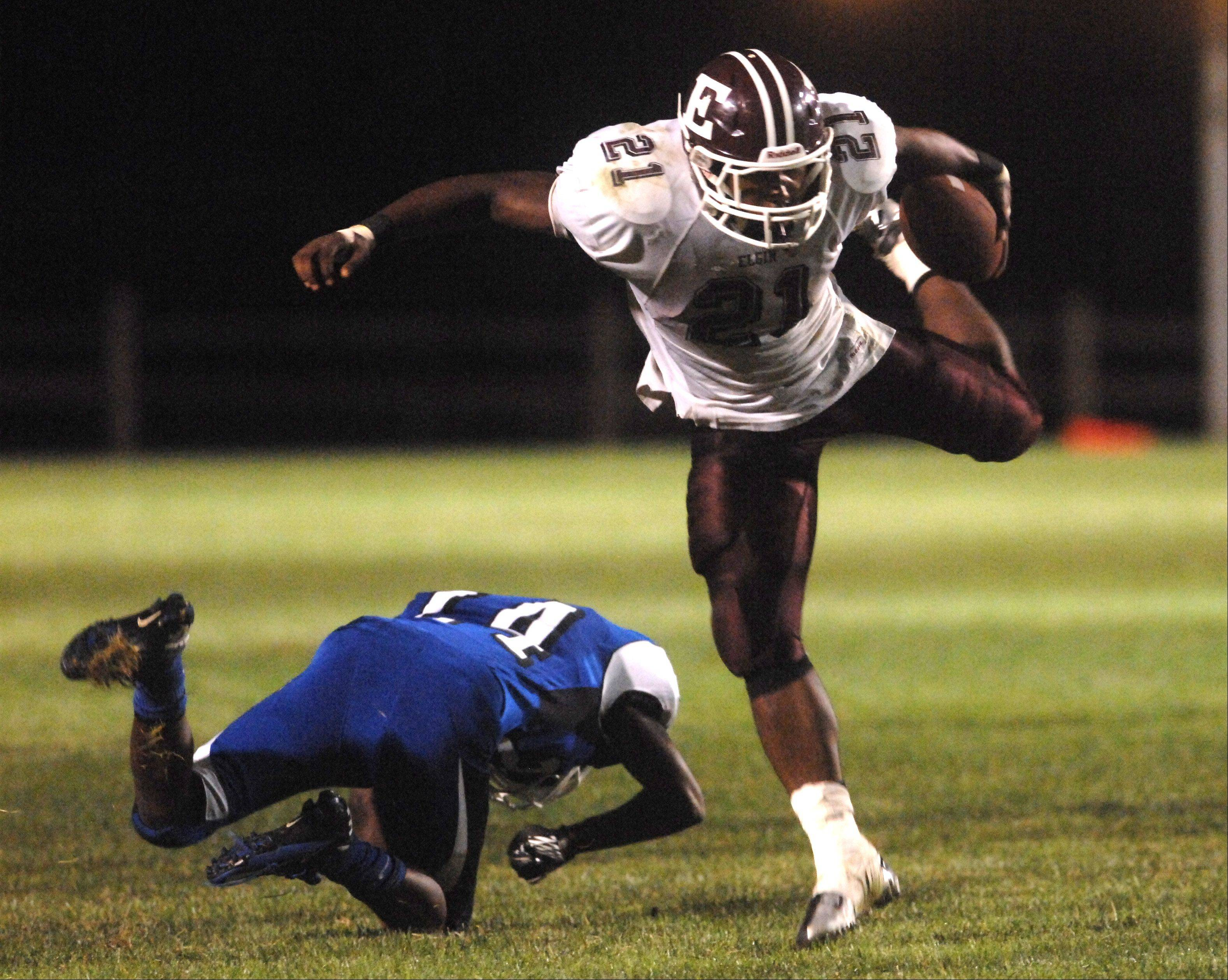 Elgin's Jaylen Clemons, 21, makes a big run during Friday's game against Larkin in Elgin.