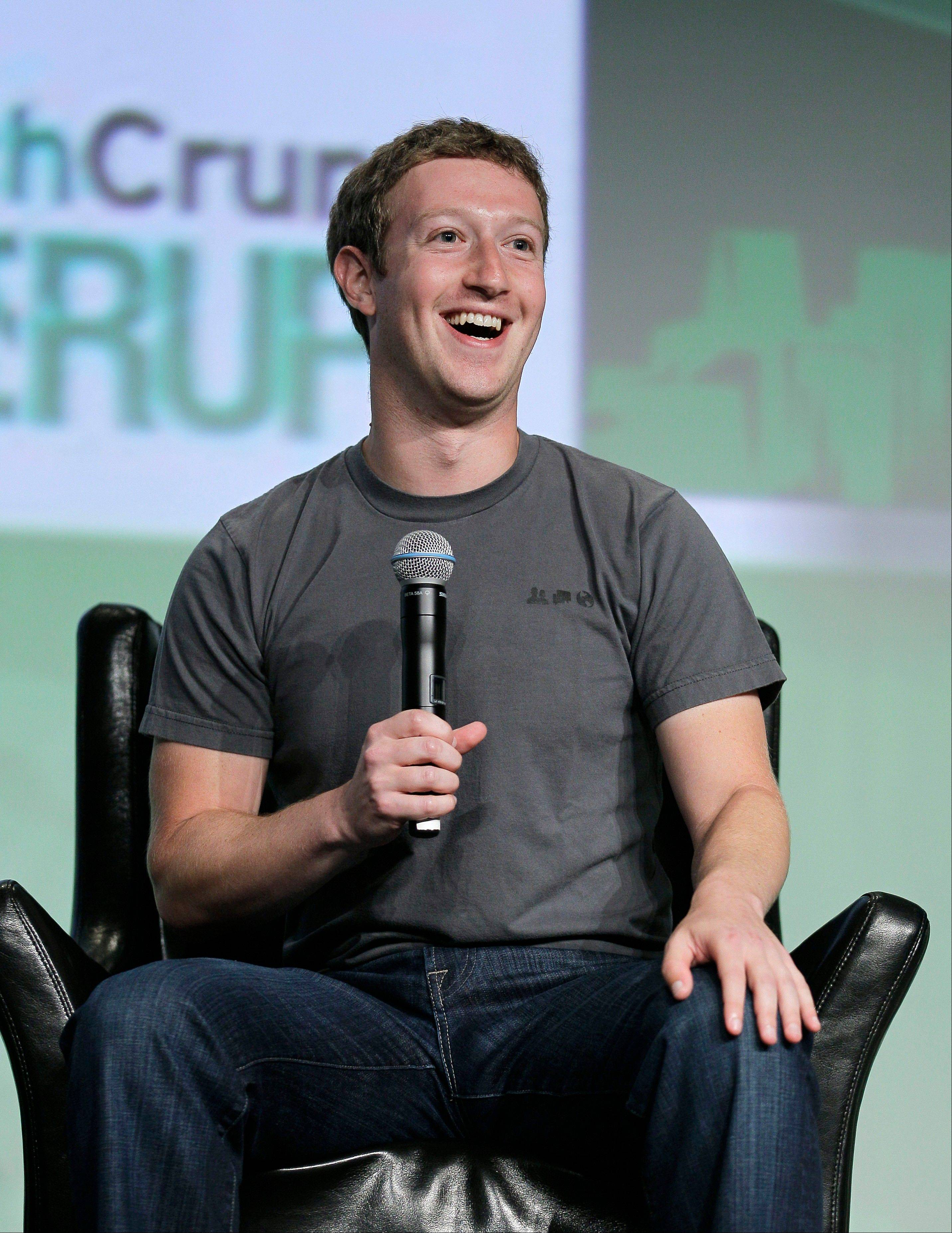 "Facebook CEO Mark Zuckerberg speaks during a ""fireside chat"" at a conference organized by technology blog TechCrunch in San Francisco, Tuesday, Sept. 11, 2012."
