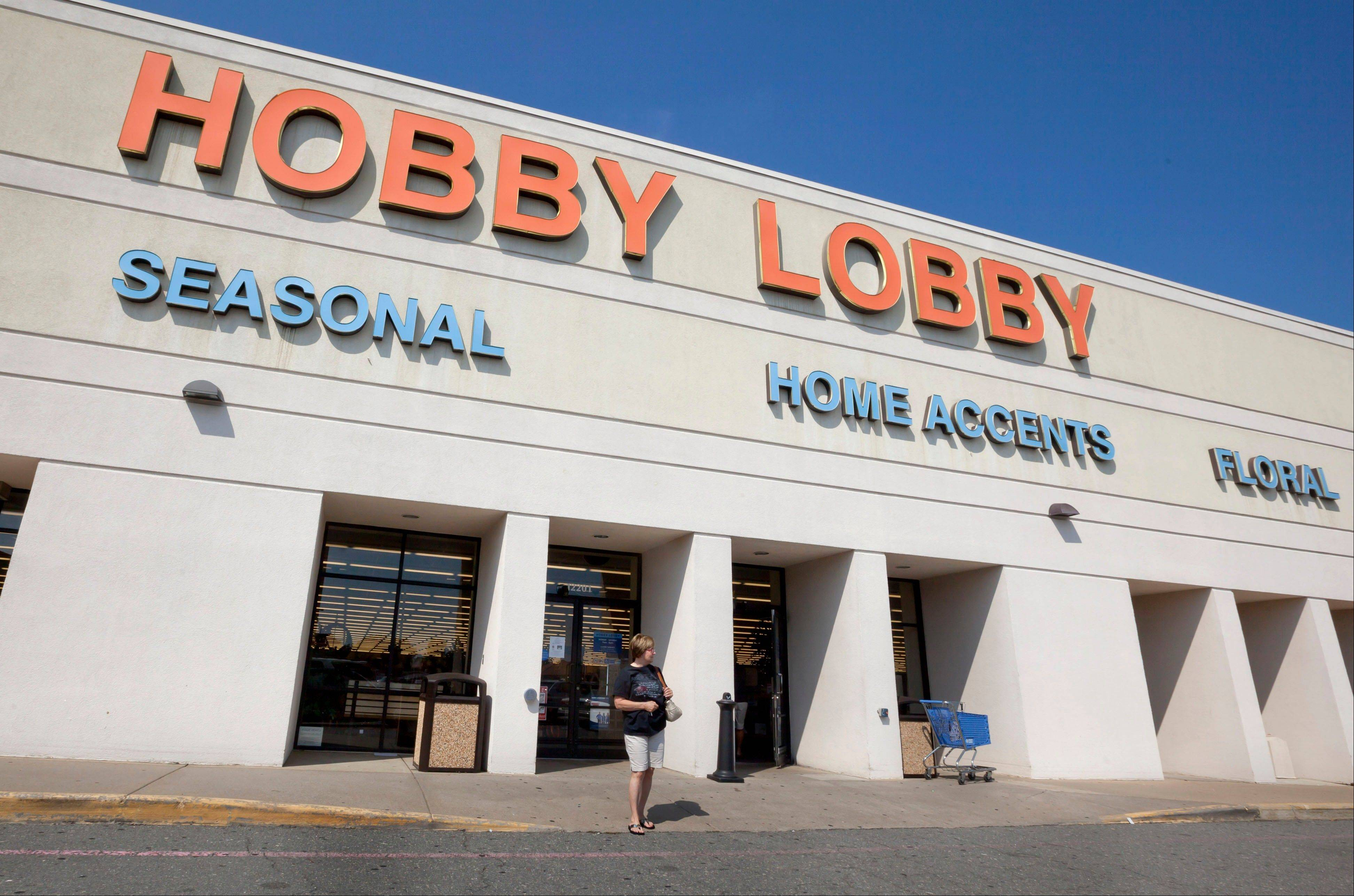 A woman walks from a Hobby Lobby Inc., store in Little Rock, Ark., Wednesday, Sept. 12, 2012. The Oklahoma City-based chain filed a federal lawsuit Wednesday over a mandate in the health reform law that requires employers to provide coverage for the morning-after pill.