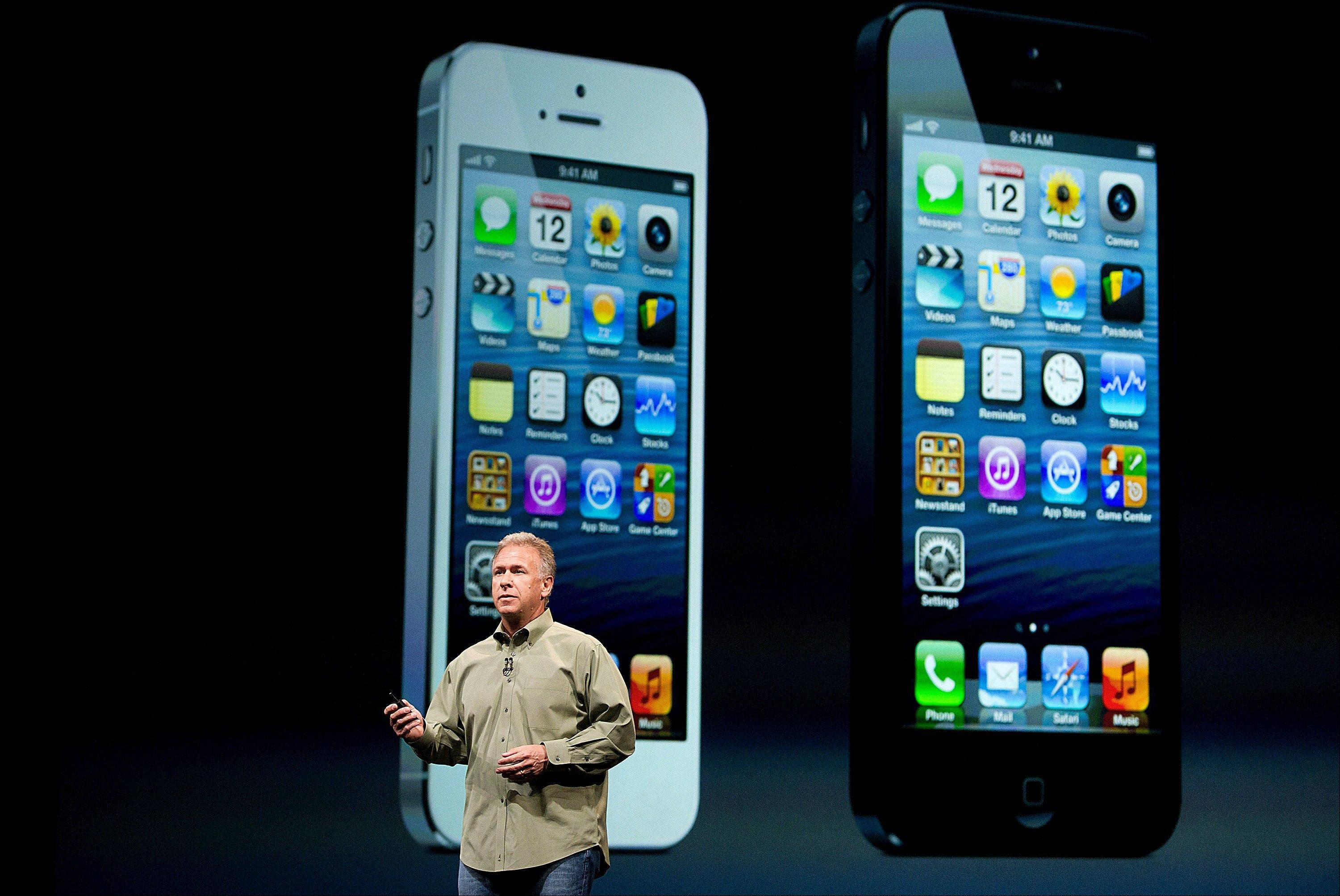 Philip Schiller, senior vice president of worldwide marketing at Apple Inc., speaks Wednesday during an event in San Francisco. Apple Inc. unveiled the iPhone 5 in an overhaul aimed at widening its lead over Samsung Electronics Co. and Google Inc. in the $219.1 billion smartphone market.