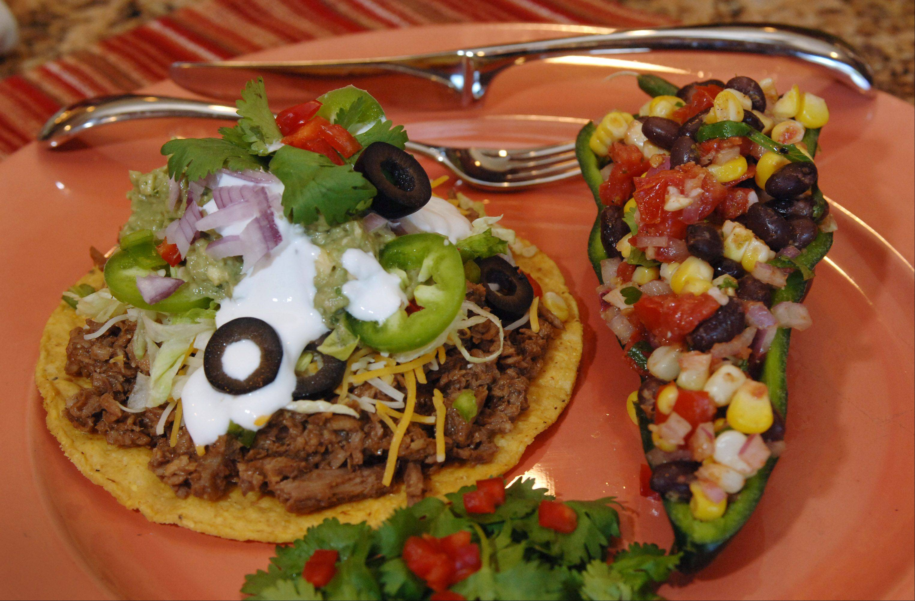 Mary Miske made shredded beef mole tostadas with plantain guacamole and corn, tomato and black bean salad. She stuffs the salad inside a seeded poblano pepper half.