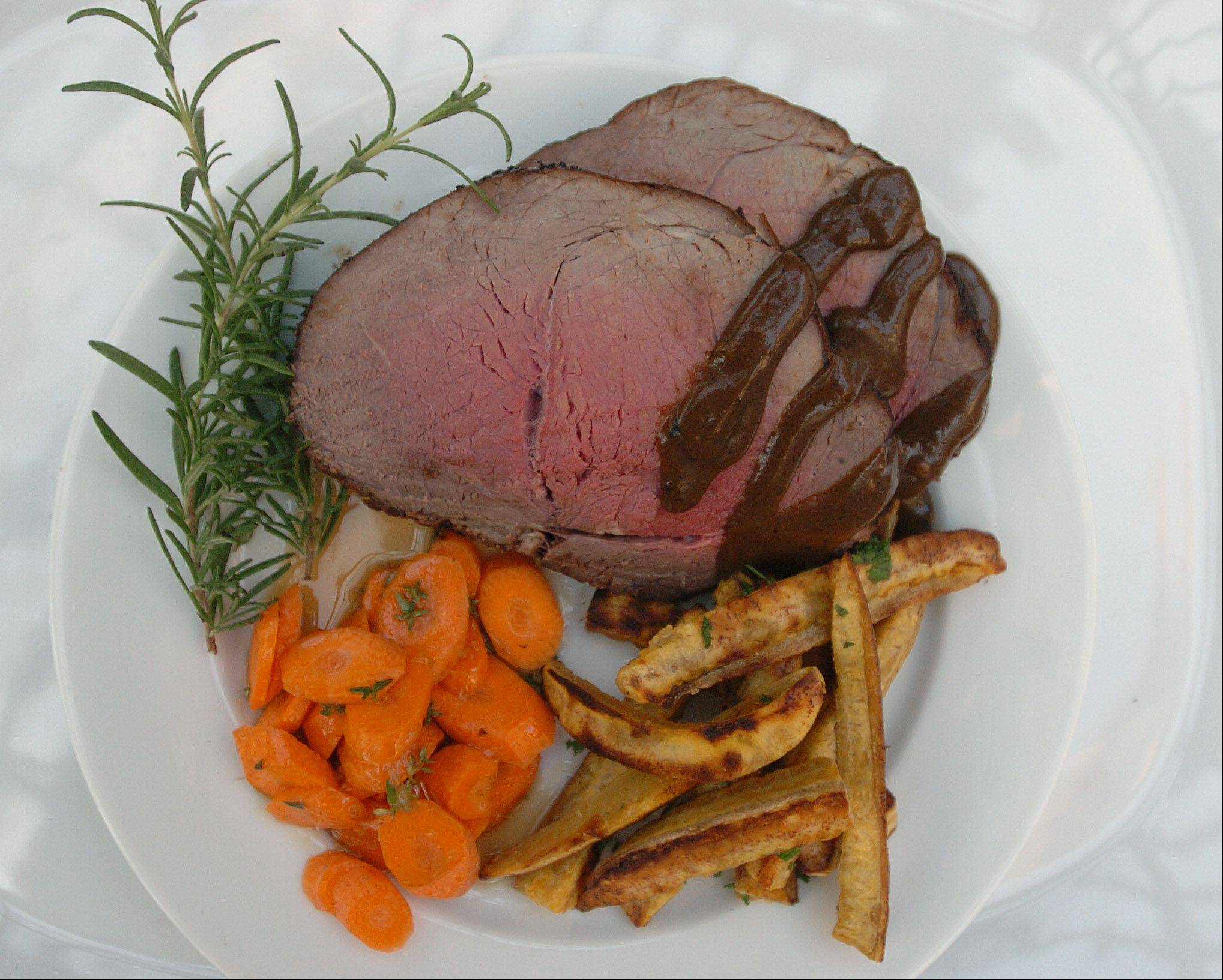 Terri Edmunds created an espresso-coffee glaze for a roasted sirloin tip. She serves it with plantain fries and citrus-glazed carrots.