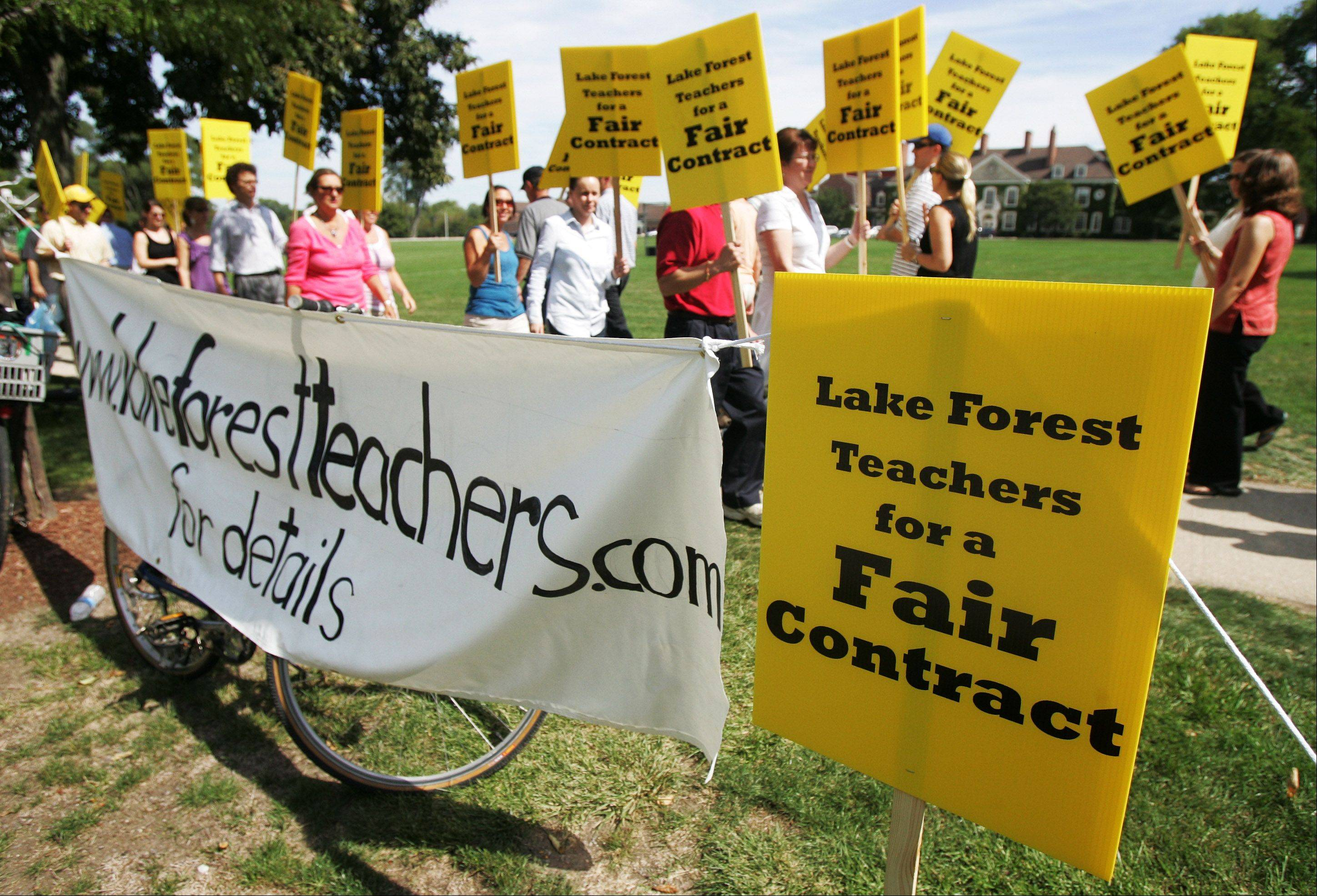 Lake Forest High School teachers picket Wednesday on the first day of their strike. Lake Forest District 115 contends the instructors are making unreasonable demands in light of a shaky economy.
