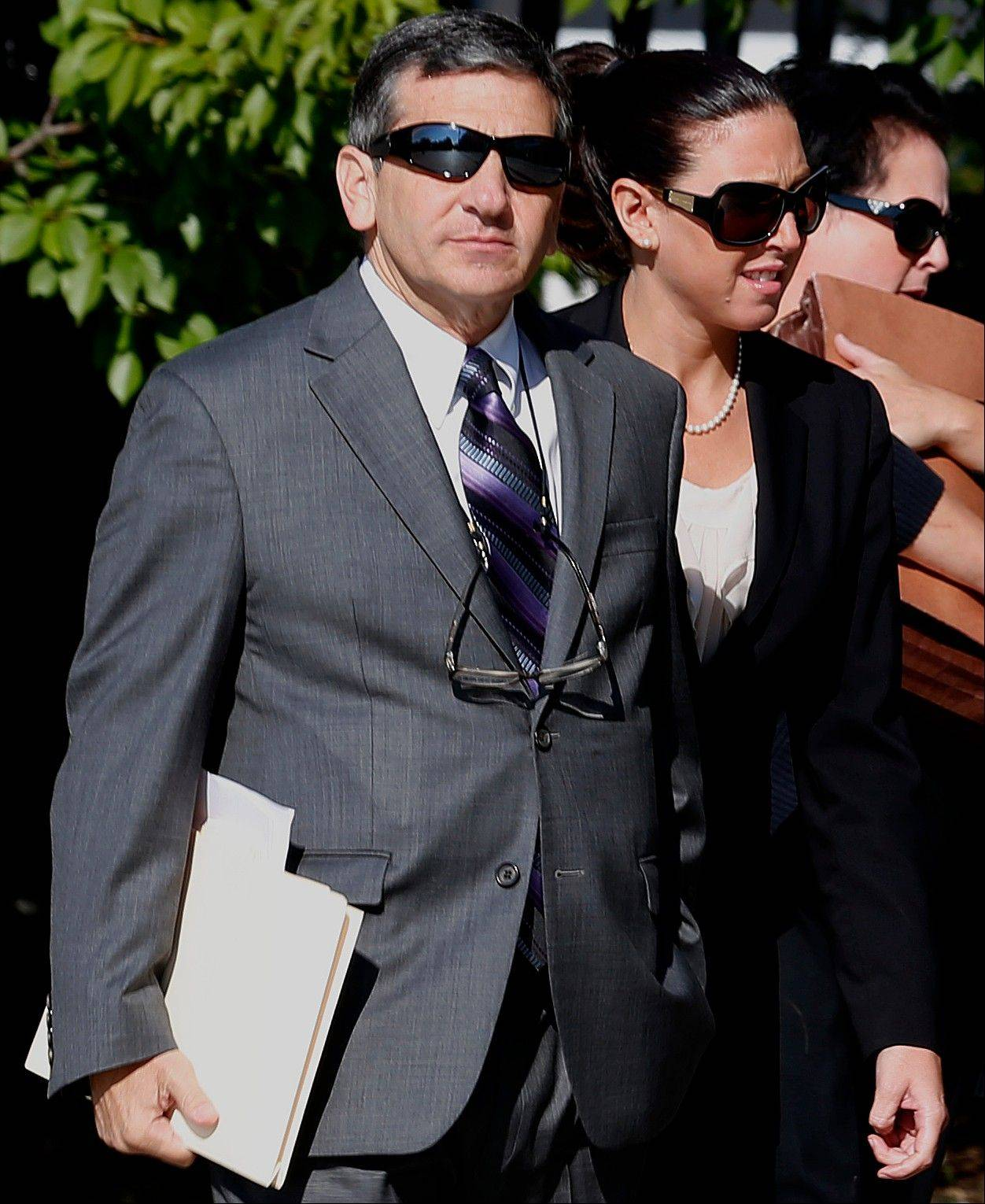 Erica DePalo, right, walks with her attorney Anthony Alfano into Essex County Superior Court before an appearance, Wednesday, Sept. 12, 2012, in Newark, N.J. DePalo, the 2011 Essex County teacher of the year, pled not guilty to charges she had a sexual relationship with a 15-year-old honors student. Prosecutors say the 33-year-old Montclair resident had a relationship with a boy in her honors English class. They say the affair started in June and ended recently. DePalo has been indefinitely suspended from her job teaching English at West Orange High School.