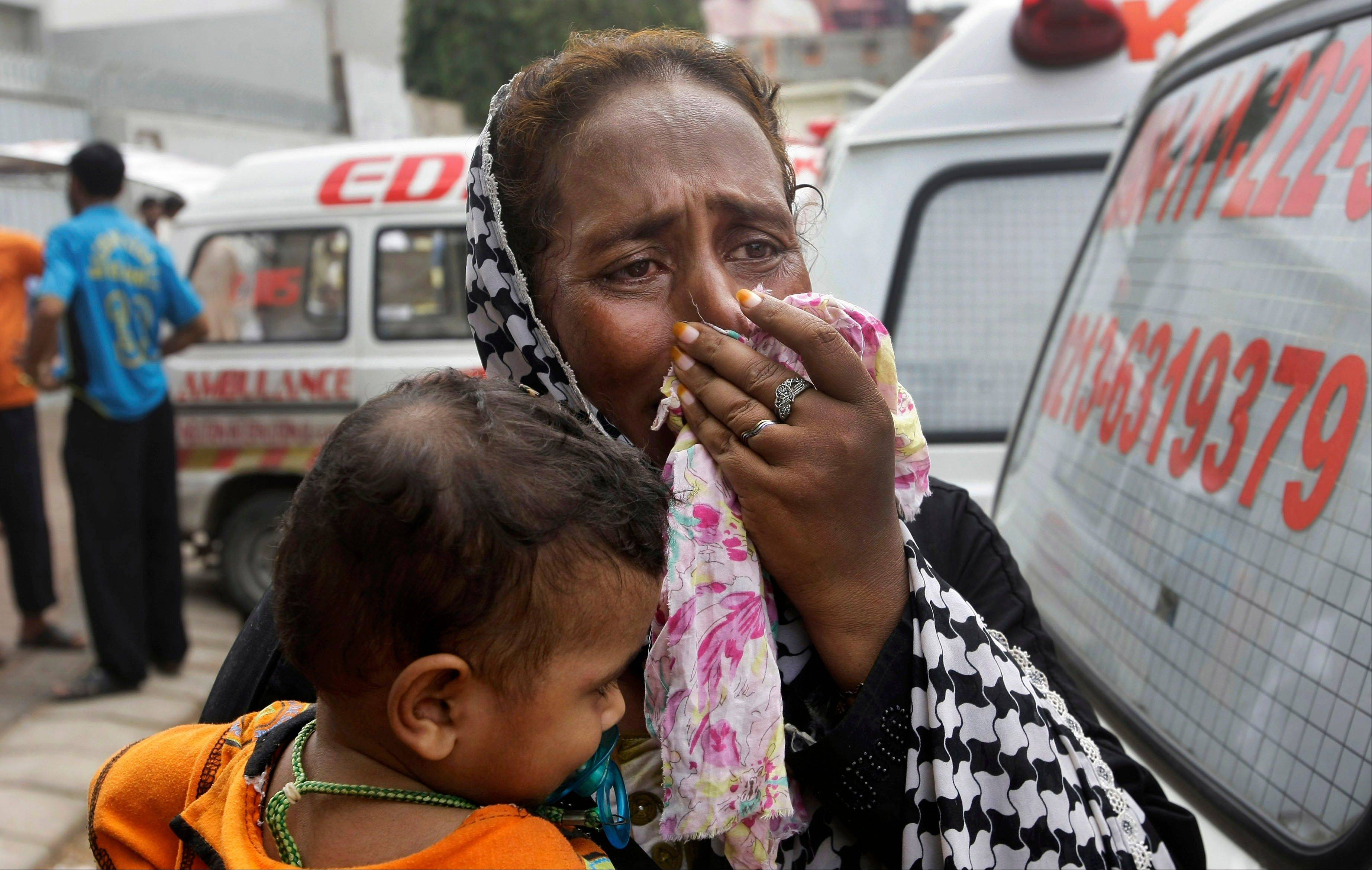 A Pakistani woman mourns the death of her family member outside a mortuary in Karachi, Pakistan, Wednesday, Sept. 12, 2012.