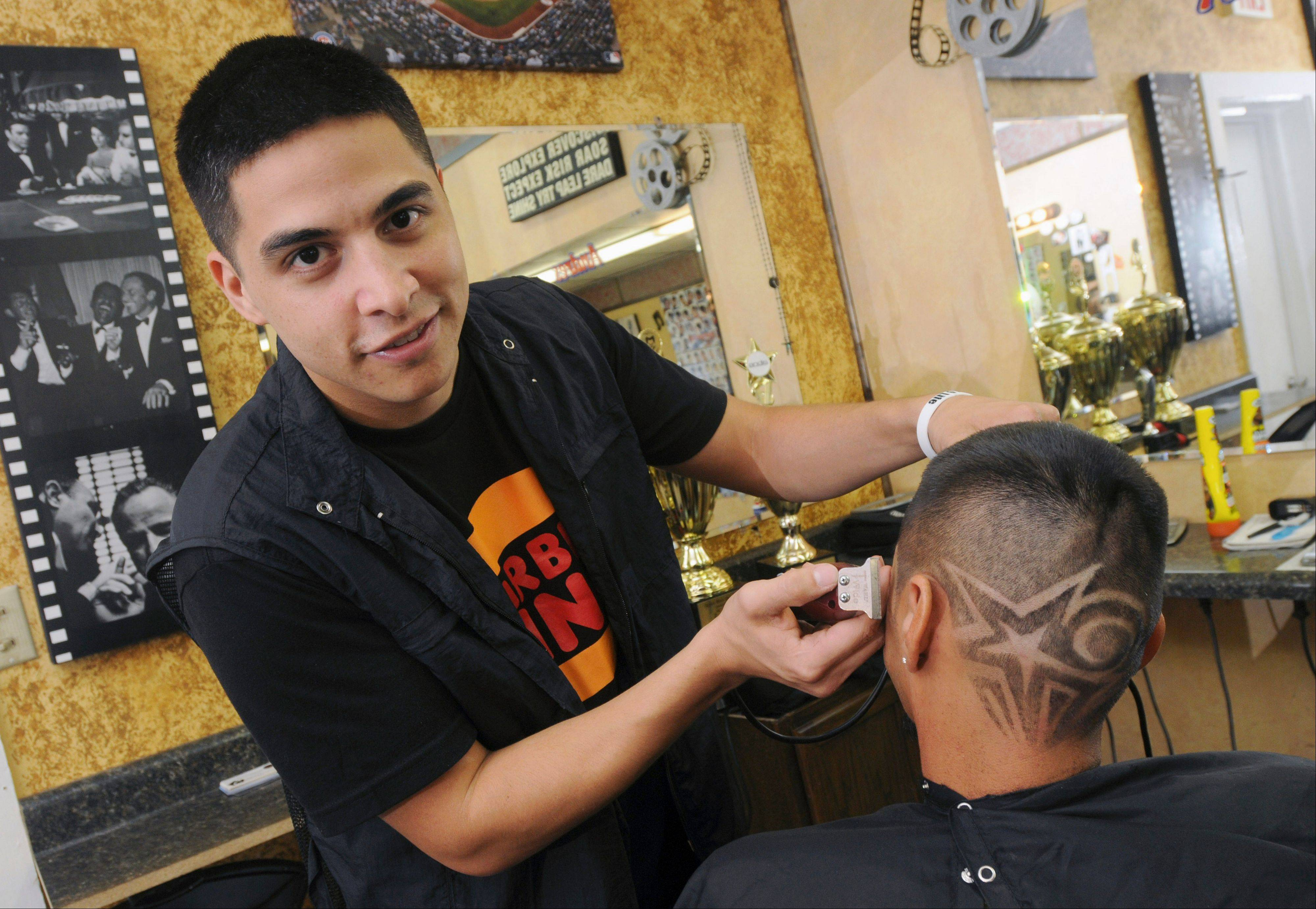 Miguel Rosas, owner of The New Style Barbershop in Moline, works on a customer's hair design. Over the Labor Day weekend, Rosas won first and second-place awards at the Xotics Hair Battle in Columbus, Ohio. He took first place for the fastest fade and second place for a freestyle competition with color where he cropped a design of Yosemite Sam into his subject's skull.