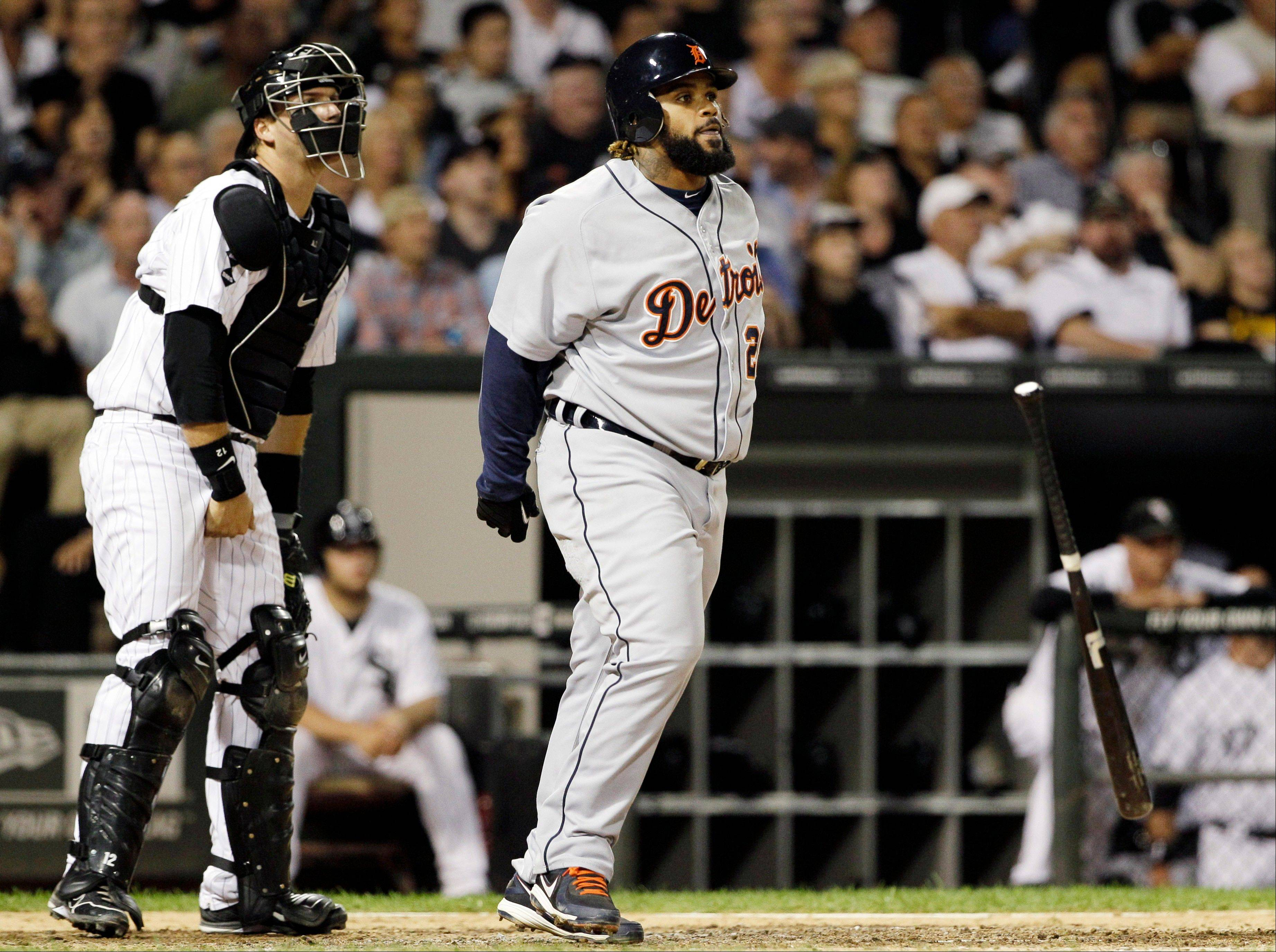 Detroit Tigers first baseman Prince Fielder, right, watches his three-run home run as Chicago White Sox catcher A.J. Pierzynski looks on Wednesday during the seventh inning at U.S. Cellular Field.