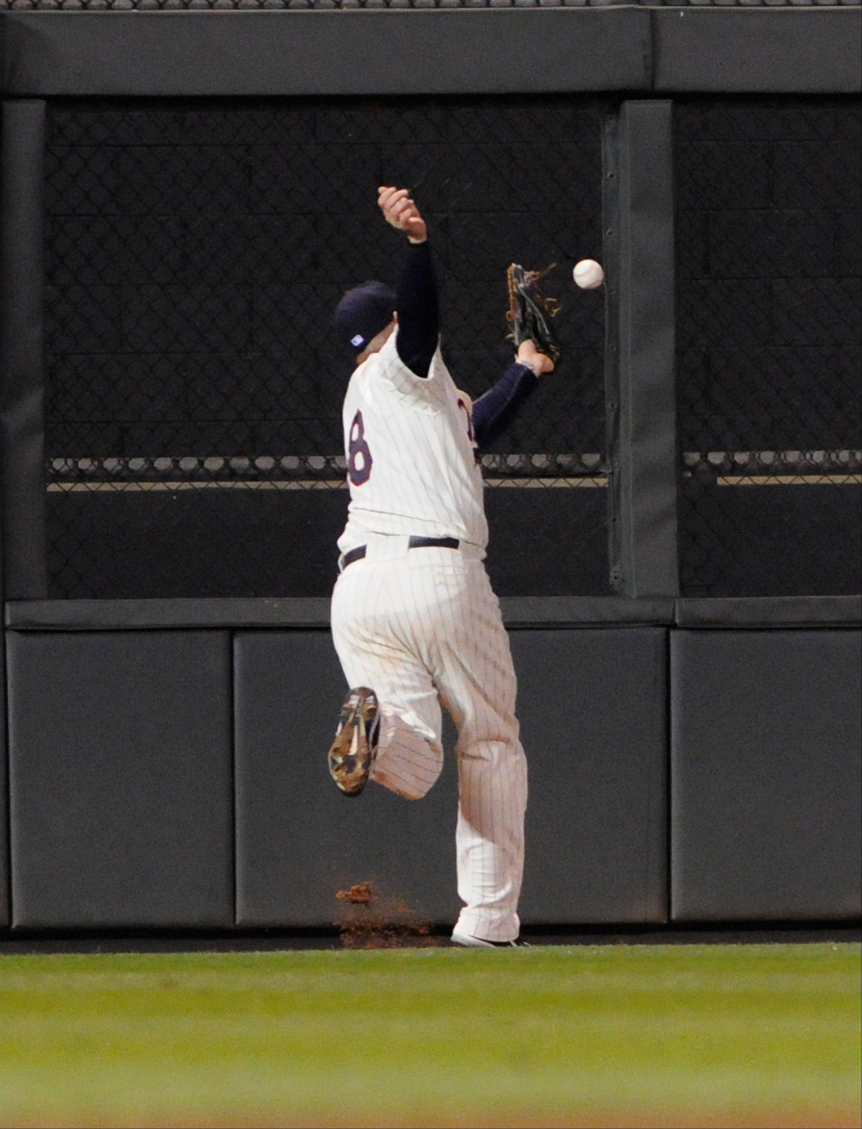 Minnesota Twins left fielder Ryan Doumit commits an error on a ball hit by Kansas City's Johnny Giavotella in the eighth inning Wednesday at home.