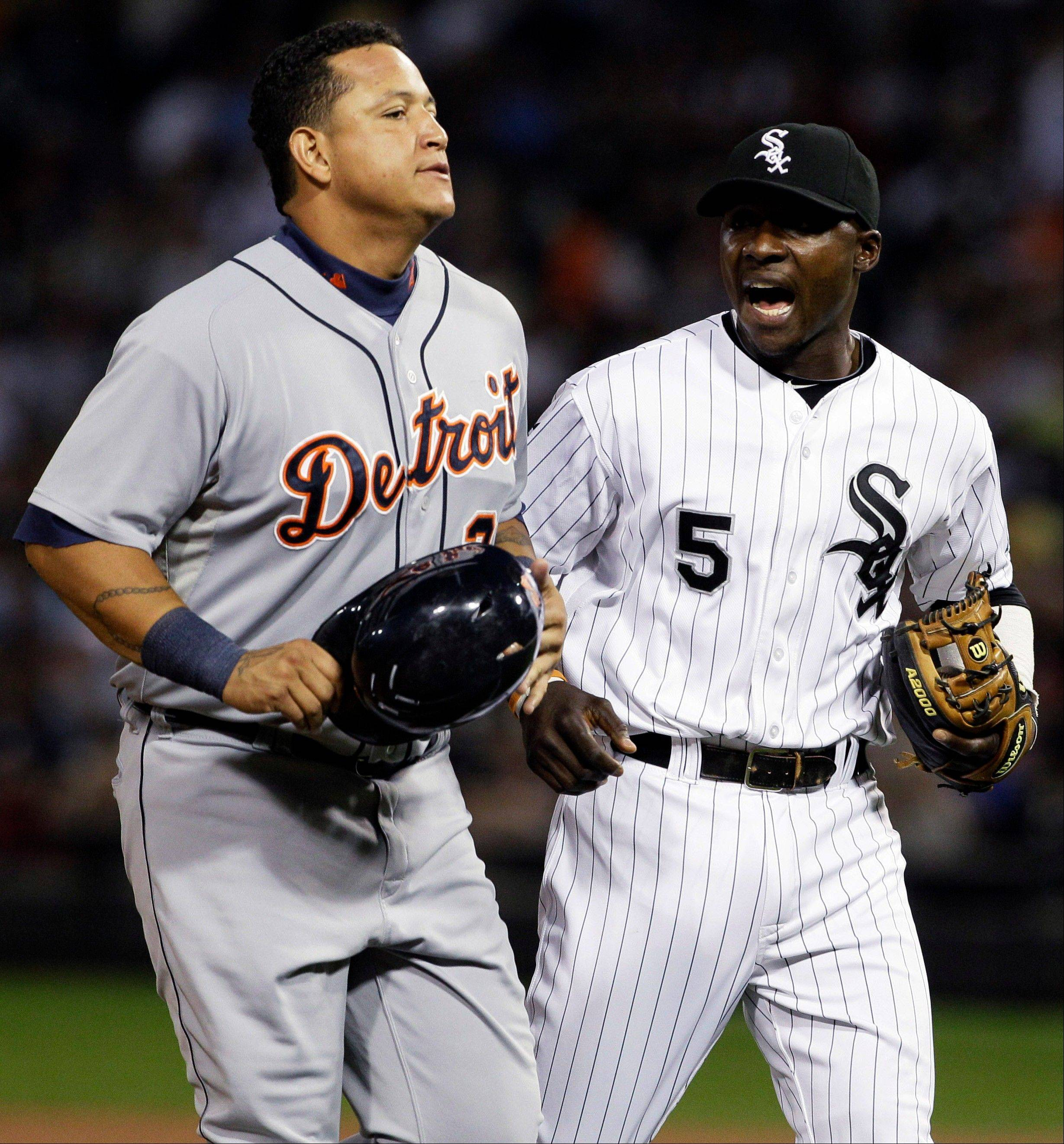White Sox second baseman Orlando Hudson talks to the Detroit Tigers� Miguel Cabrera Wednesday during the first inning at U.S. Cellular Field.