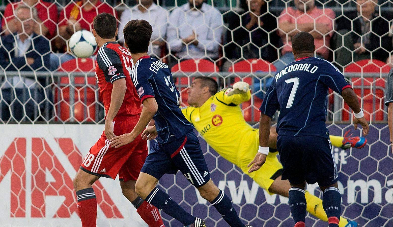Alvado Fernandez, left, of the Fire watches his header beat Toronto FC goalkeeper Milos Kocic on Wednesday.