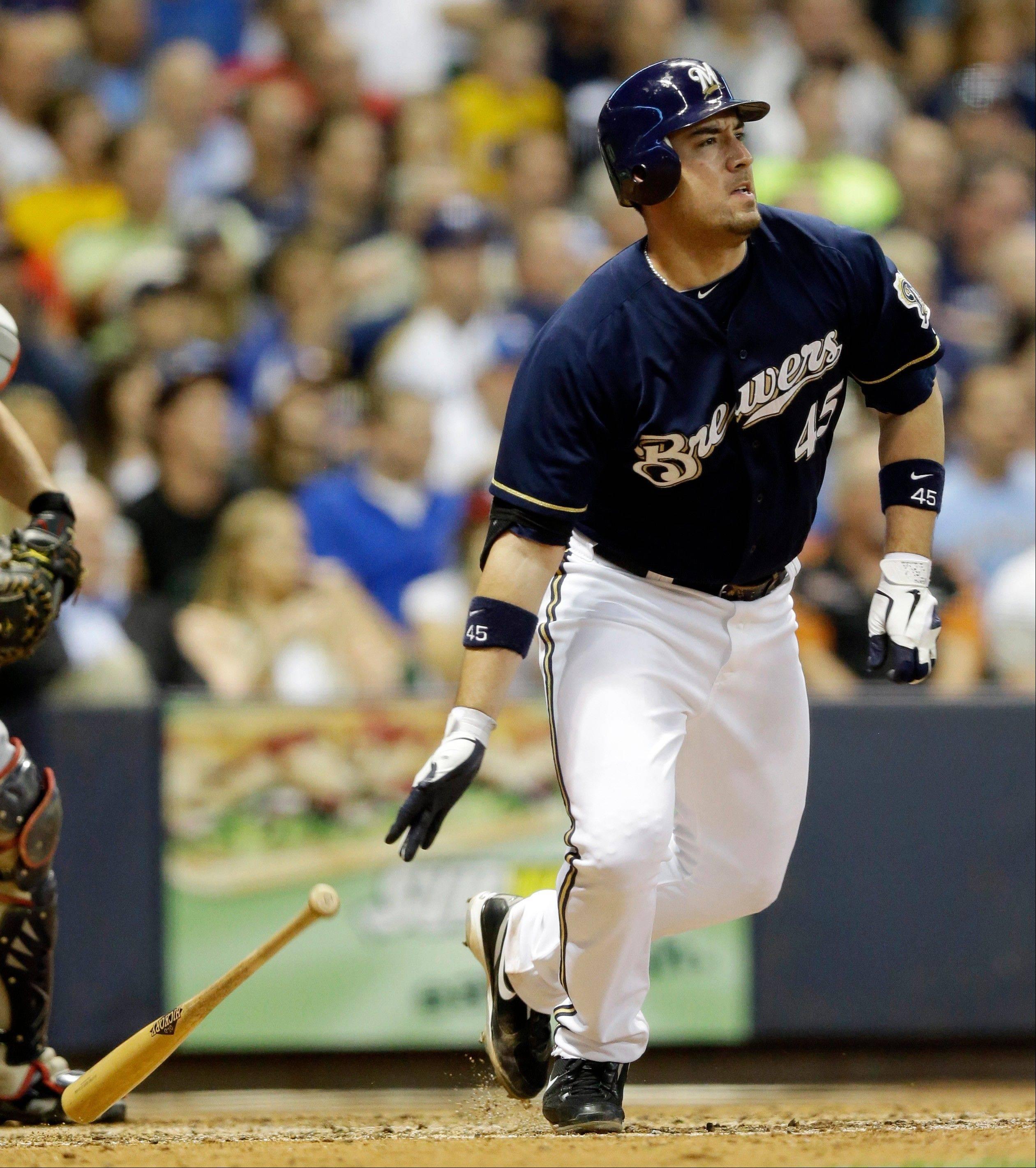 The Brewers� Travis Ishikawa hits a three-run double during the fifth inning against Atlanta on Wednesday in Milwaukee.