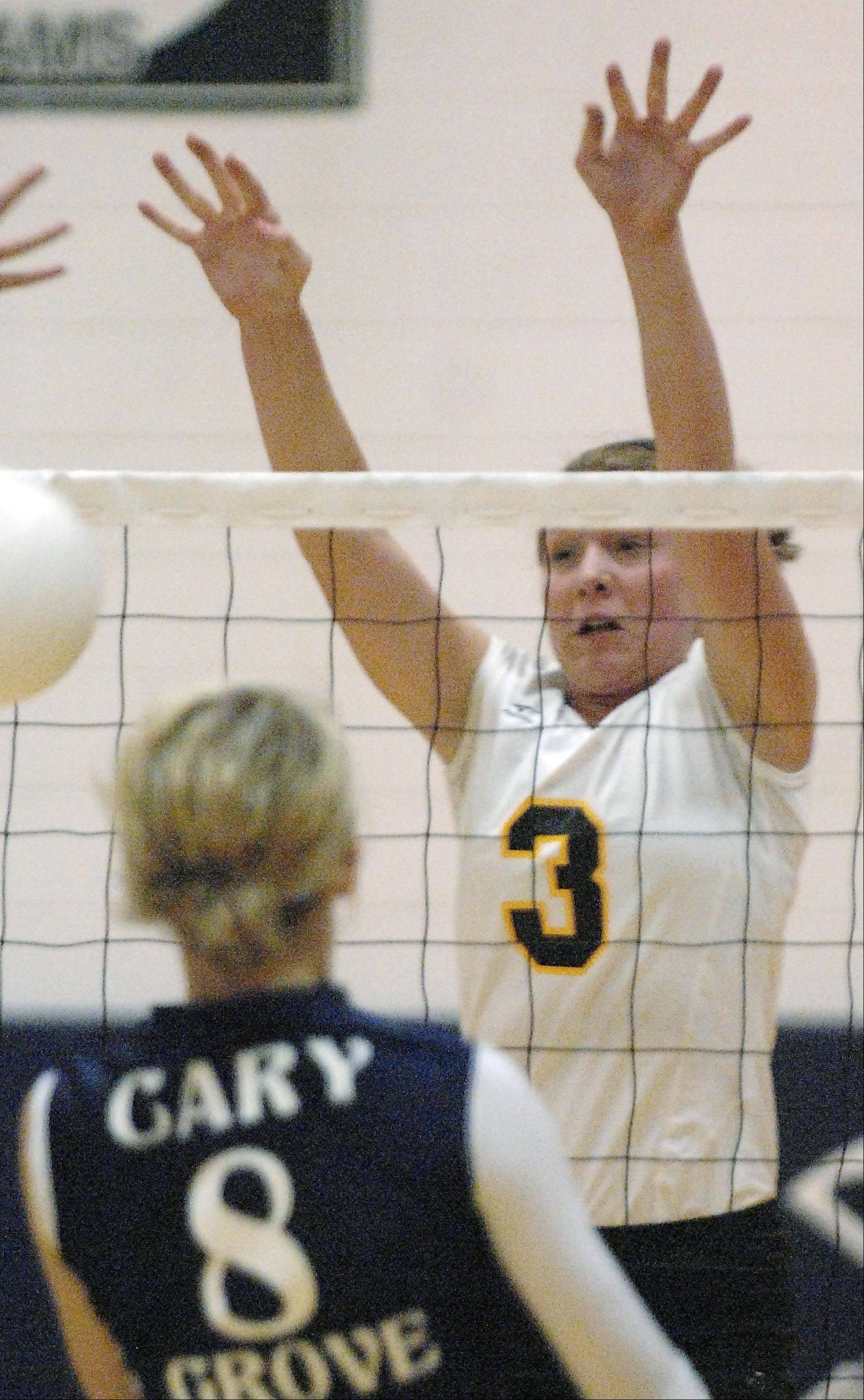 Jacobs� Alyssa Ehrhardt blocks back a shot by Cary-Grove�s Abby Schebel Tuesday in Cary.