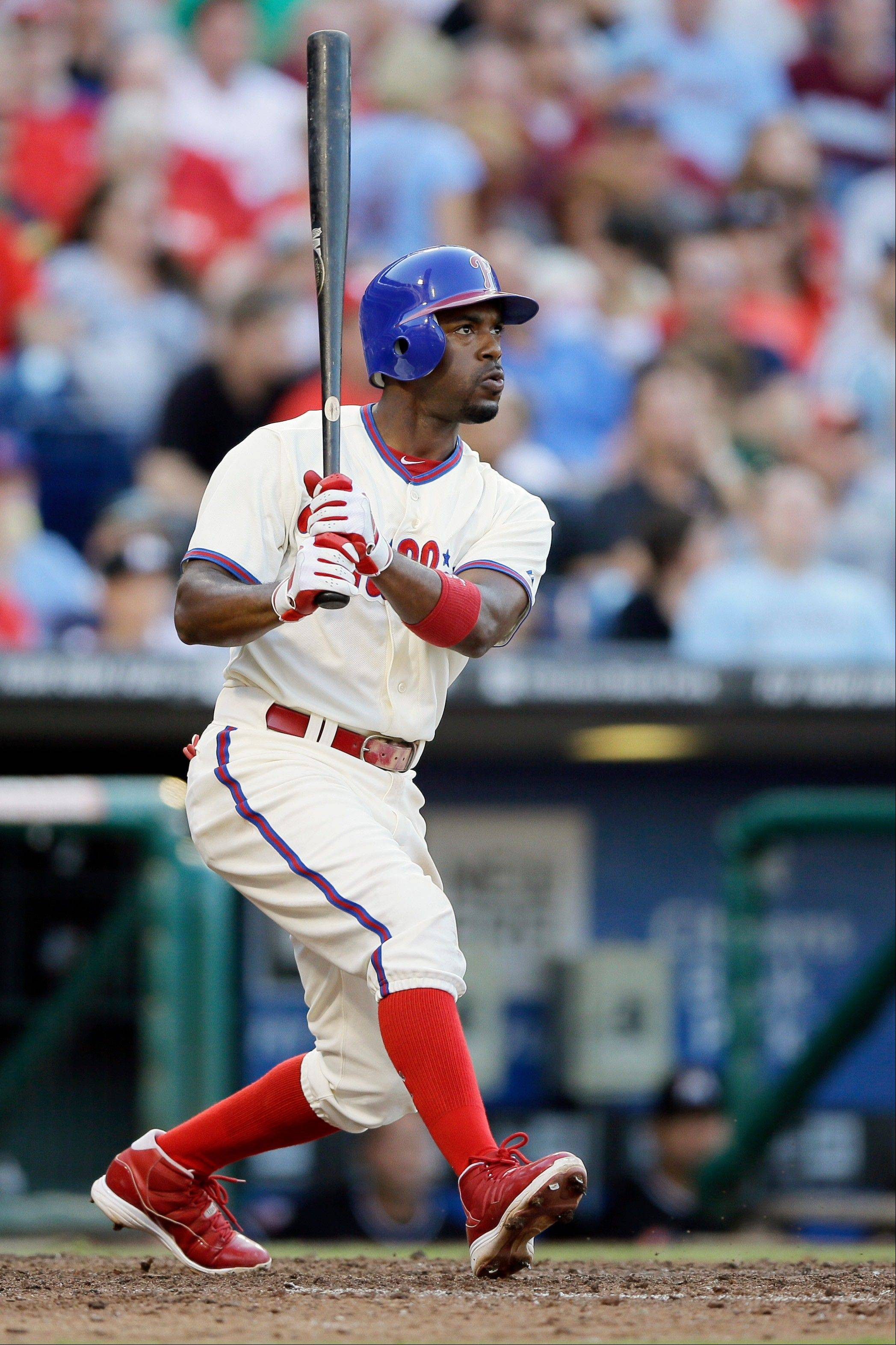 The Phillies� Jimmy Rollins watches his two-run home run off Miami starting pitcher Josh Johnson in the seventh inning Wednesday in Philadelphia.